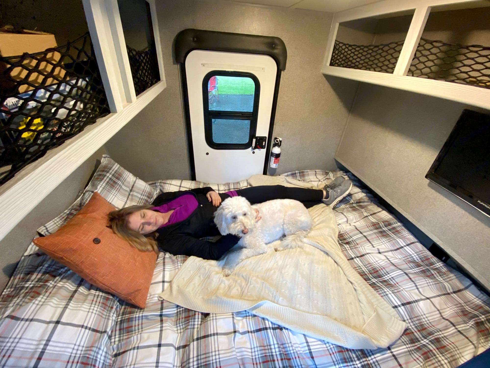 """The interior boasts a Queen size bed, comfy memory foam mattress, Stereo/CD/DVD Player, Flat Screen TV, Electric Heater, A/C, Tons of overhead storage and two doors with opening windows with privacy covers. Bed will accommodate folks up to 6'5"""".. Rockwood Geo Pro RK12 2018"""