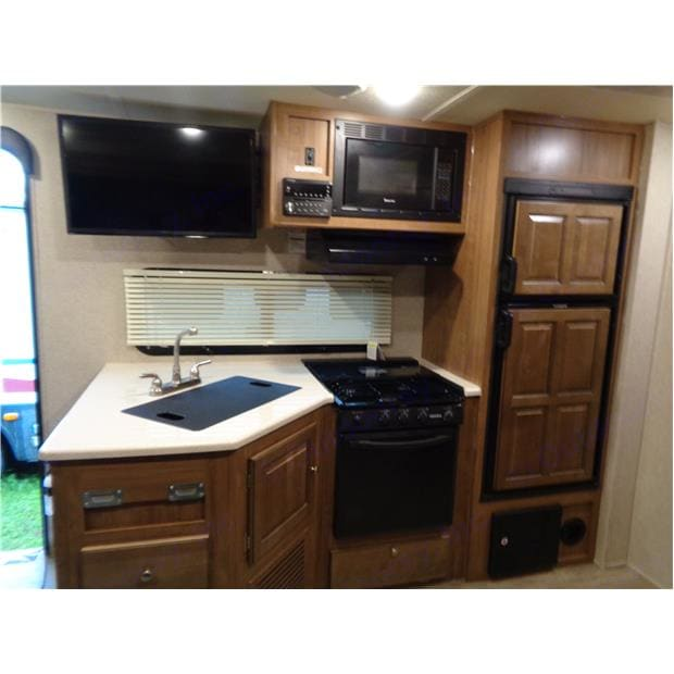 Great Kitchen with stove top, oven, and microwave and dual sink. . Forest River Rockwood Mini Lite 2019