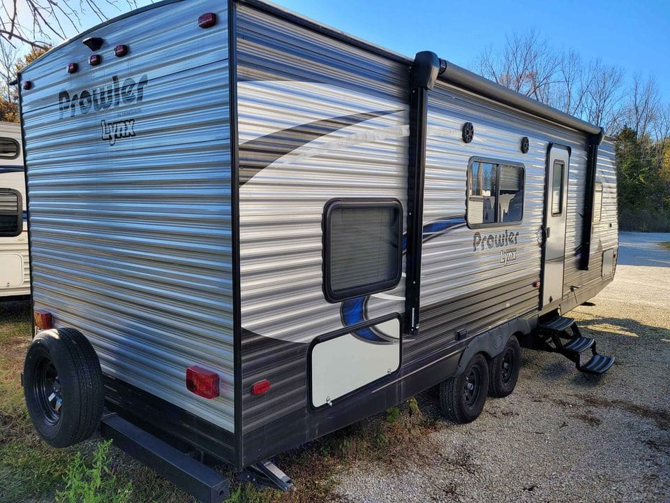 Large awning with blue light up underbody lights.  The blue lights work great to keep bugs away while still being able to see at night.. Heartland Prowler Lynx 2018