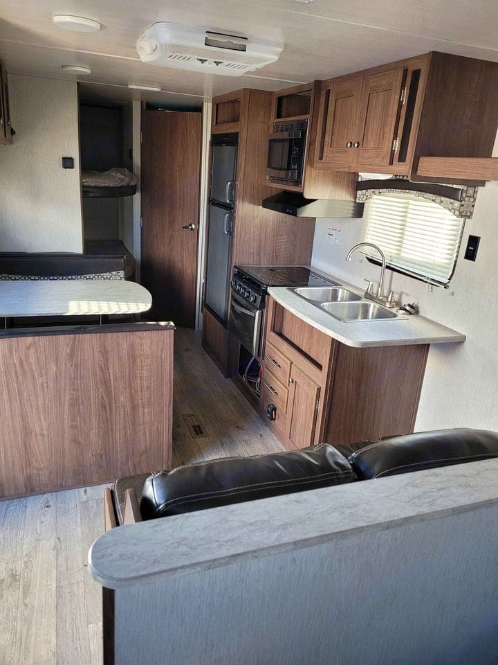 Stocked with supplies, the kitchen has the room you need and a comfortable place to sit and relax after a long day.. Heartland Prowler Lynx 2018