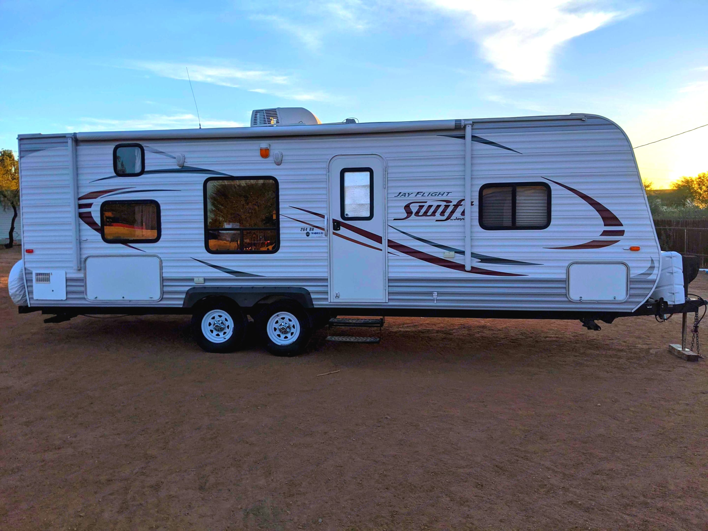 Windows for each bunk in the back, large dining table window, door window, and front window for queen bed. Jayco Jay Flight Swift 2014