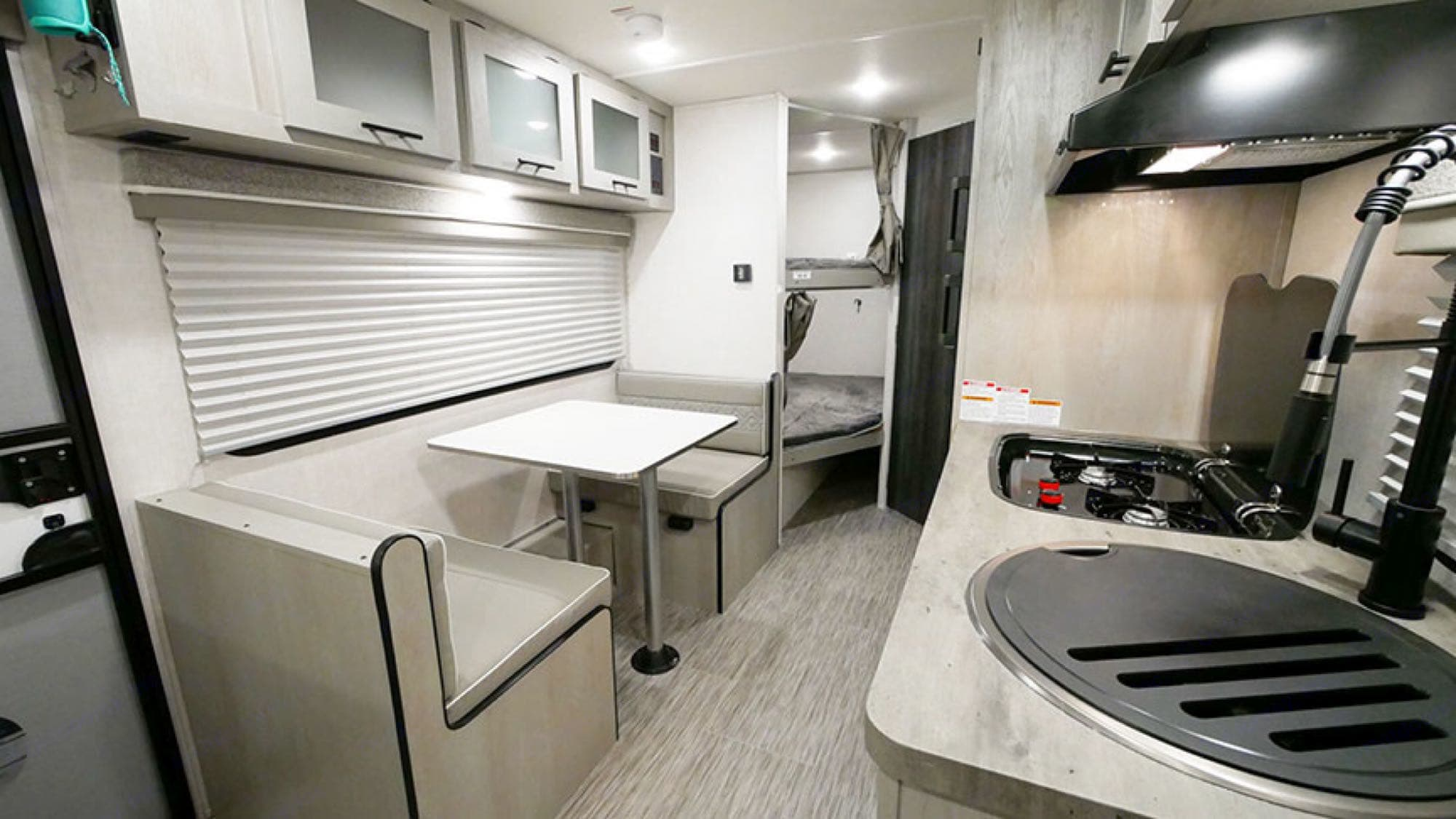 dinette and double over double bunks. Forest River IBEX 19MBH 2021