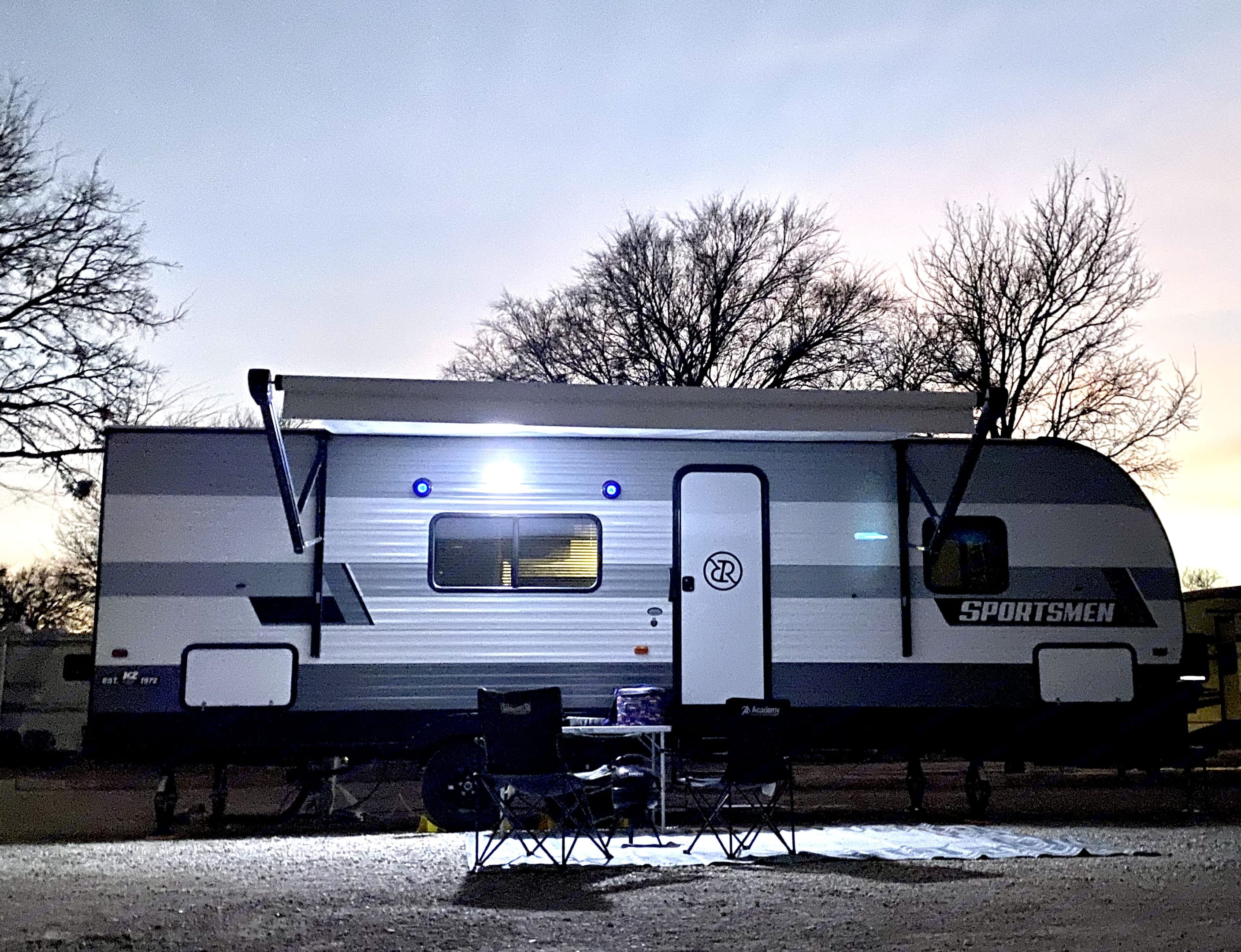 Night set up with outdoor light and speakers for that dinner on the grill. . K-Z Manufacturing Sportsmen 2021