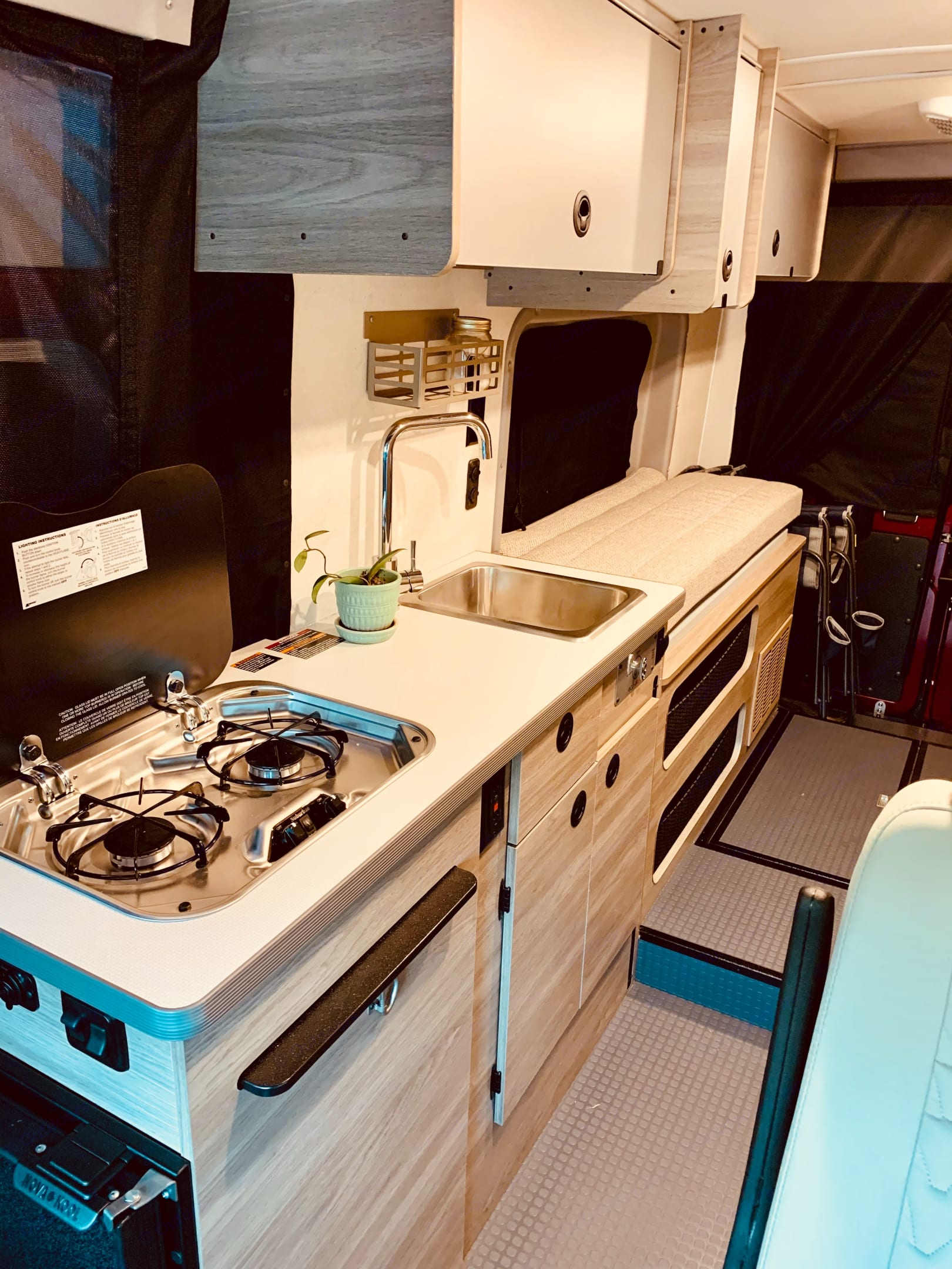 2 burner stove and spacious storage in the kitchen!  Extra counter space pull out on the side!. Winnebago Solis 59PX 2021
