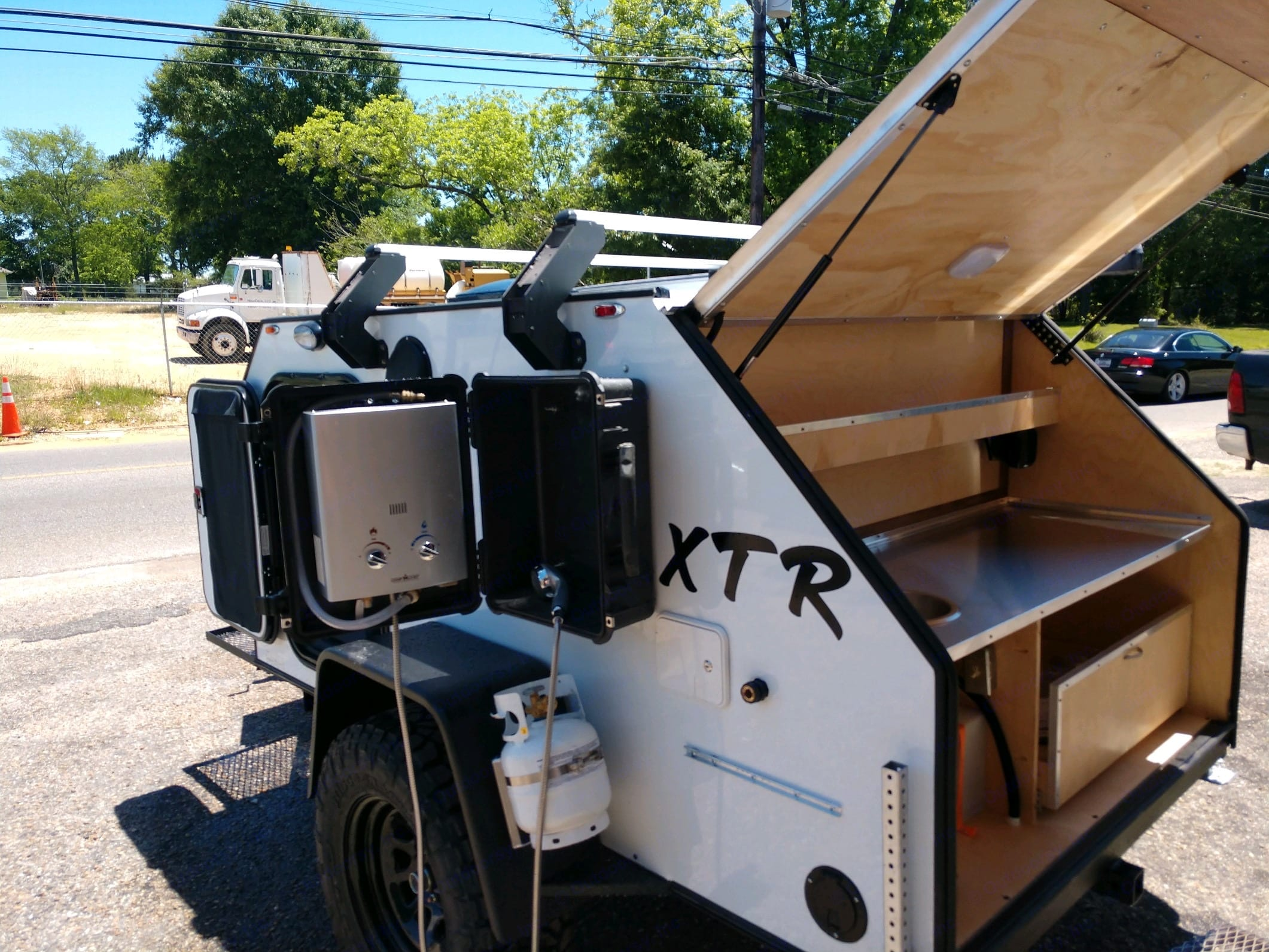 Instant hot water shower and on board propane.. Vintage Trailer Works XTR 2020
