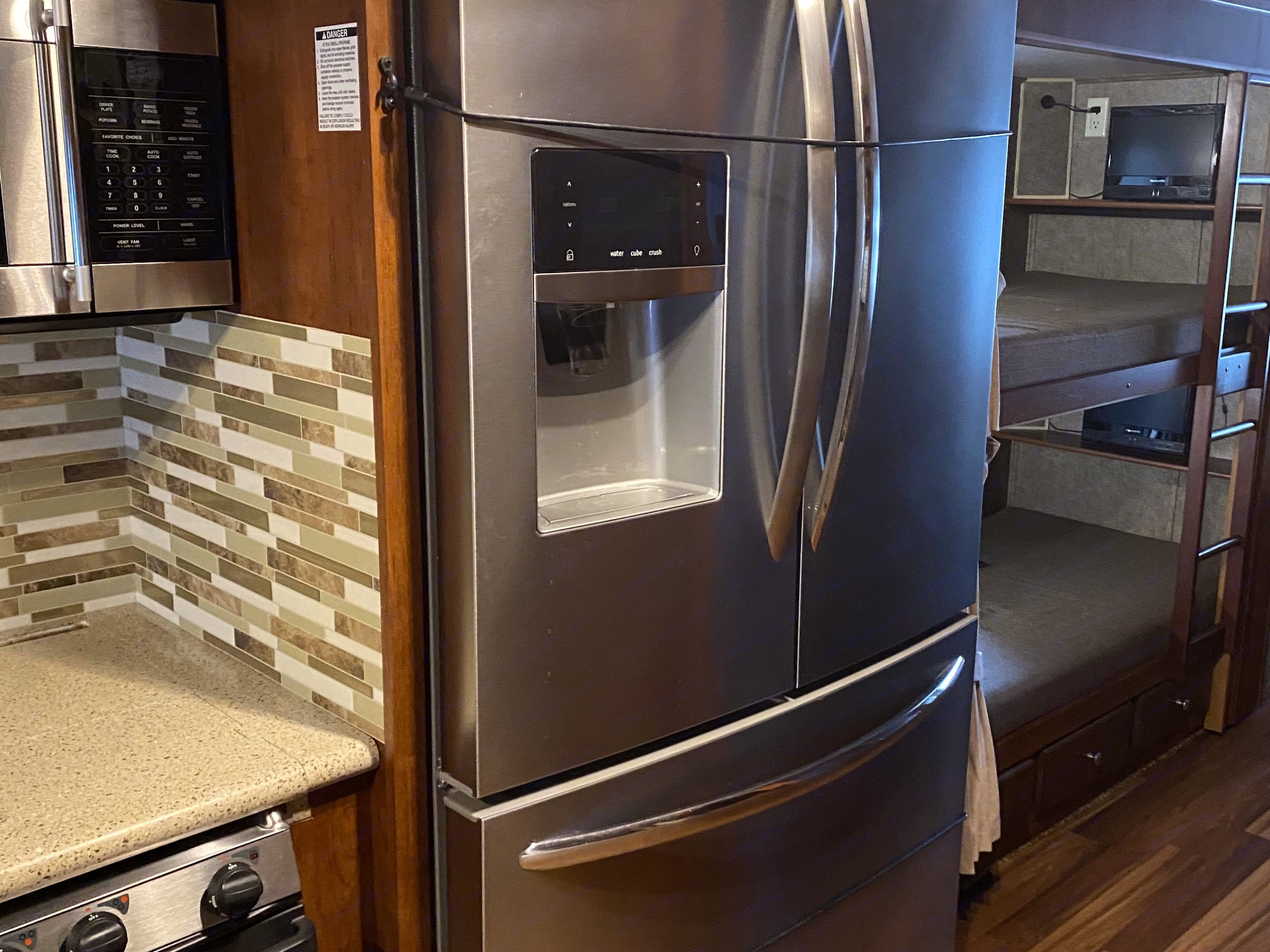 That fridge!!  Just like home, plenty of room to stock up for the entire week!. Forest River Georgetown 2014