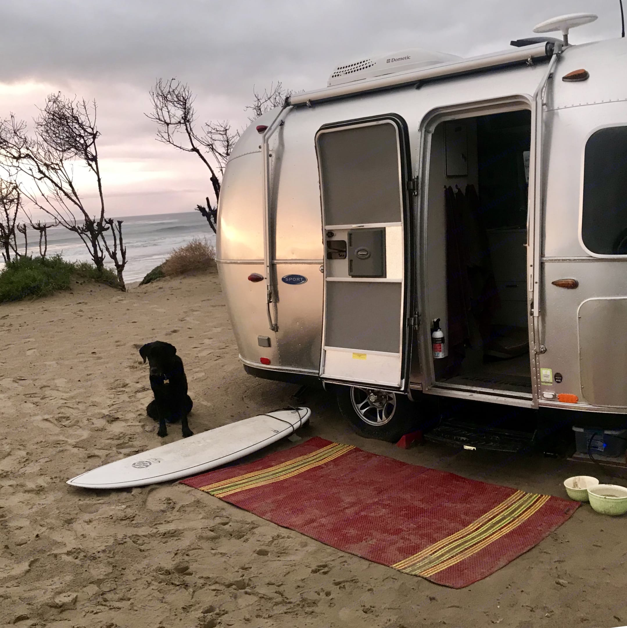 Besie and our dog Asha enjoying beach camping and adventures at Jalama. Airstream Sport 2016