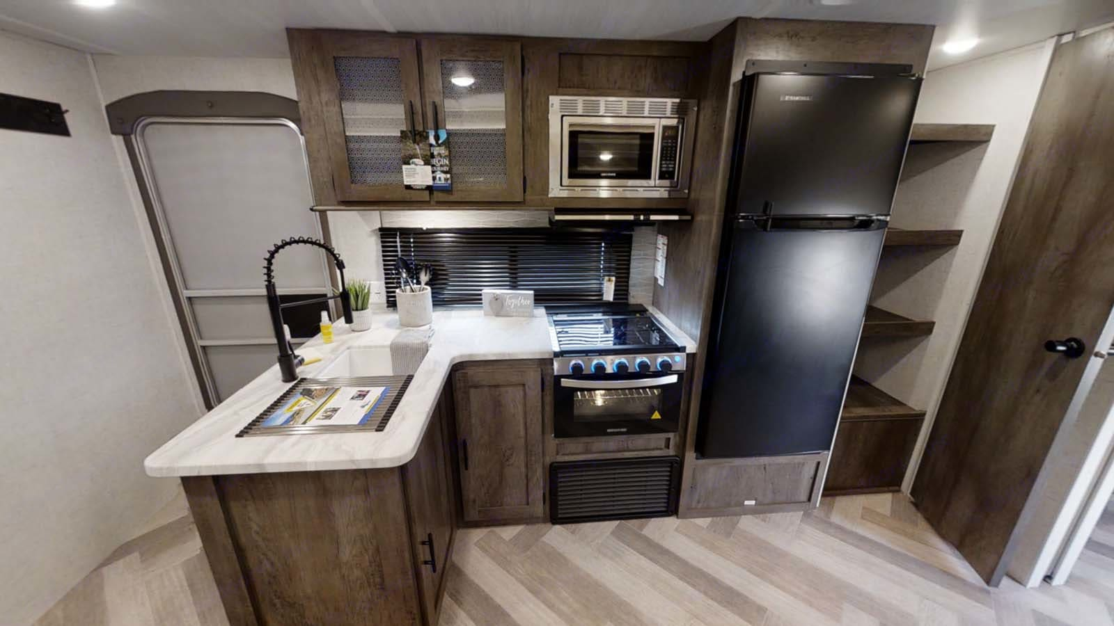Full kitchen with pantry. . Forest River Wildwood 2021