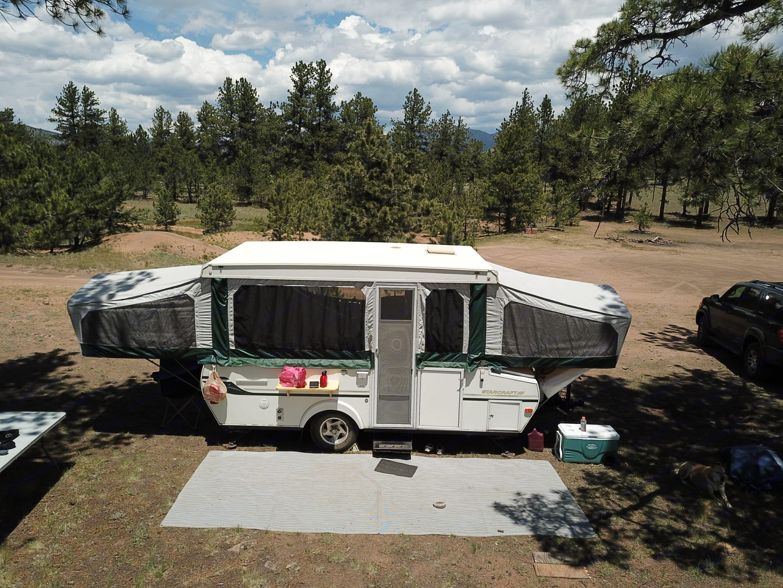 Front of camper with the outdoor mat.. Starcraft Centennial 2004