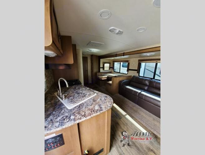 Here is the view from the door to the trailer. Shows the kitchen, couch and dinette.. Shadow Cruiser 208QBS 2015