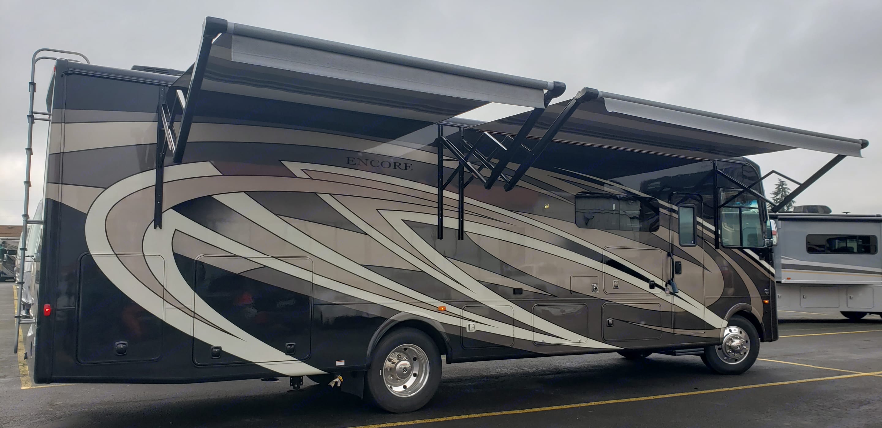 Camping Side of RV with Awnings Extended. Coachmen Encore 2021