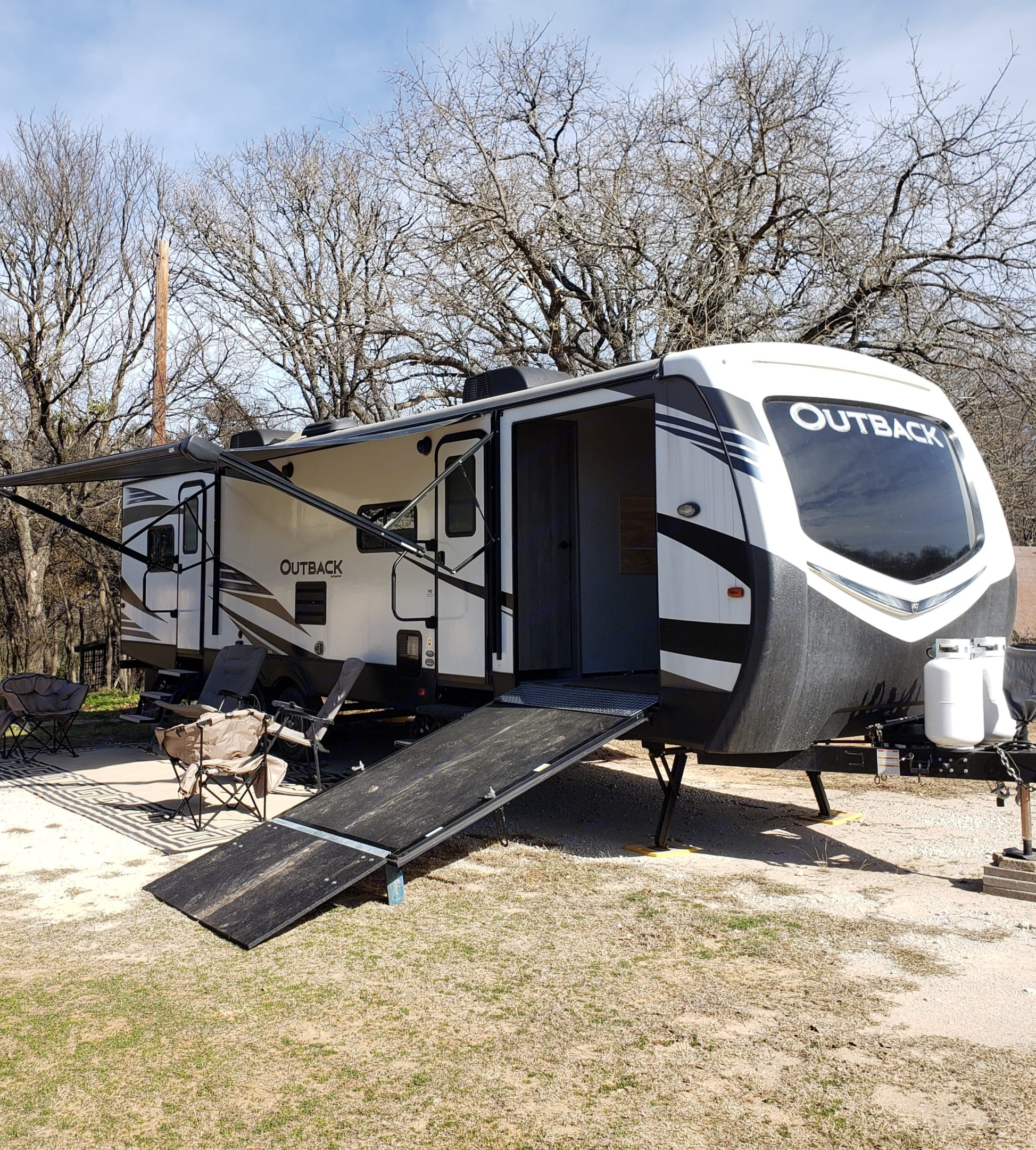 Unique side loading ramp to take your Big motorcycle or 4x4 with you on your RV getaway.. Keystone Outback 2019