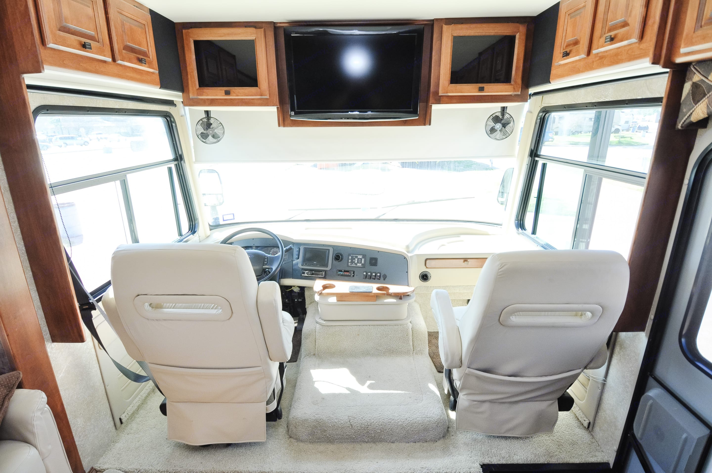 Roomy cockpit with sun visors and TV.. Tiffin Motorhomes Allegro 2011