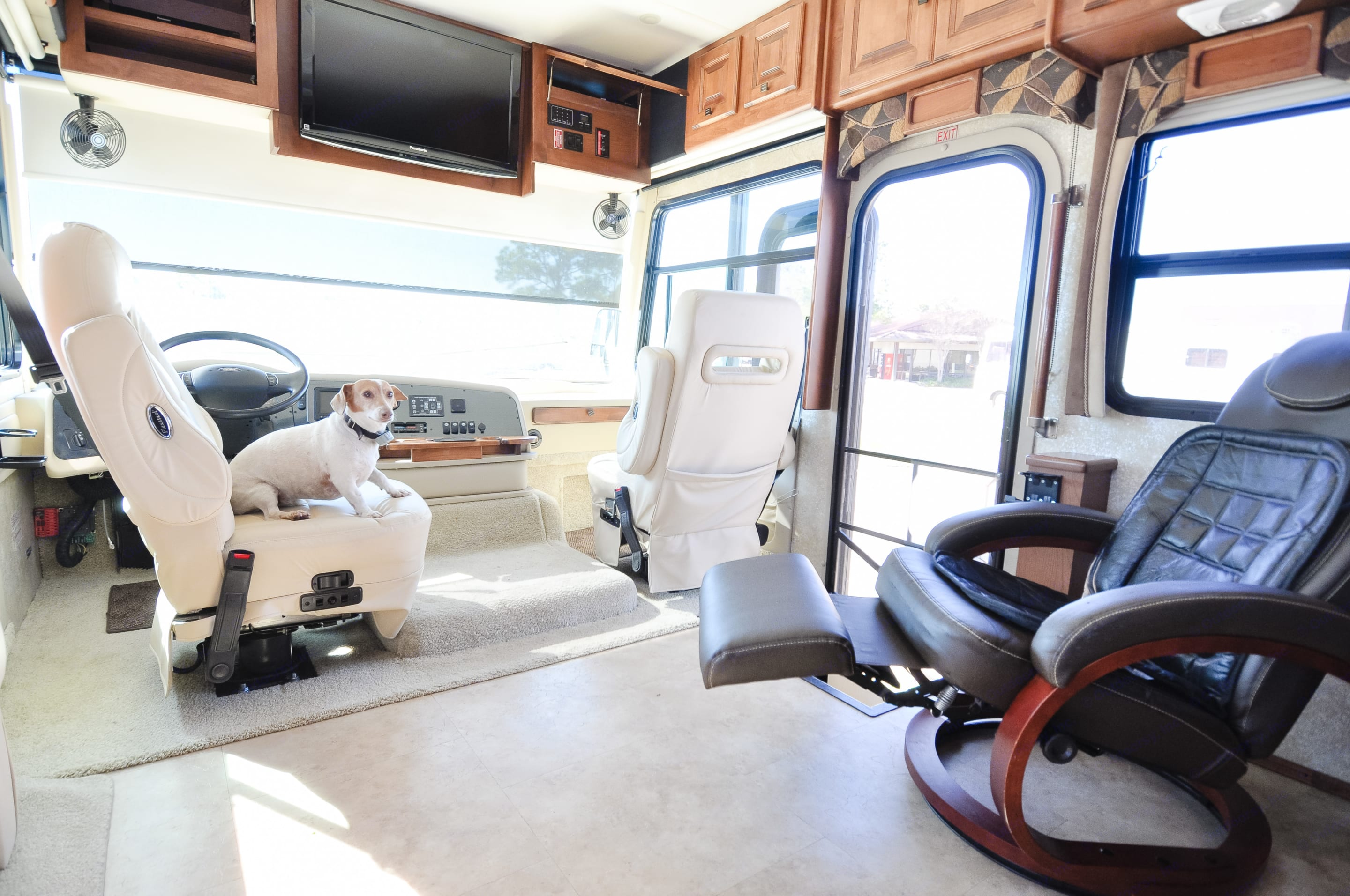 Captains chair swivels with extra reclining chair.  PET FRIENDLY (Coco). Tiffin Motorhomes Allegro 2011
