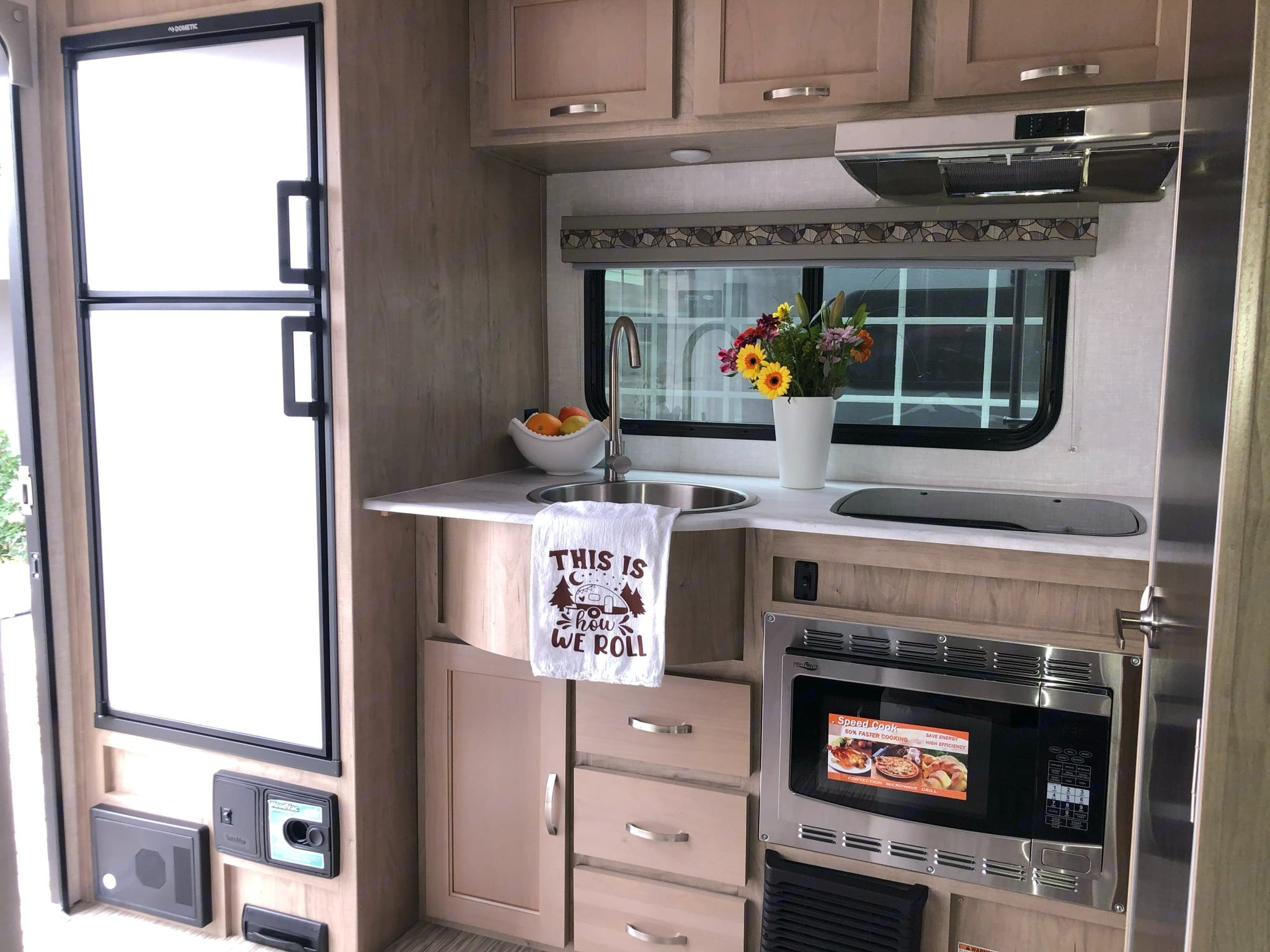 Two stove burner, sink, convection microwave, and large fridge and freezer. Forest River R-Pod 2020