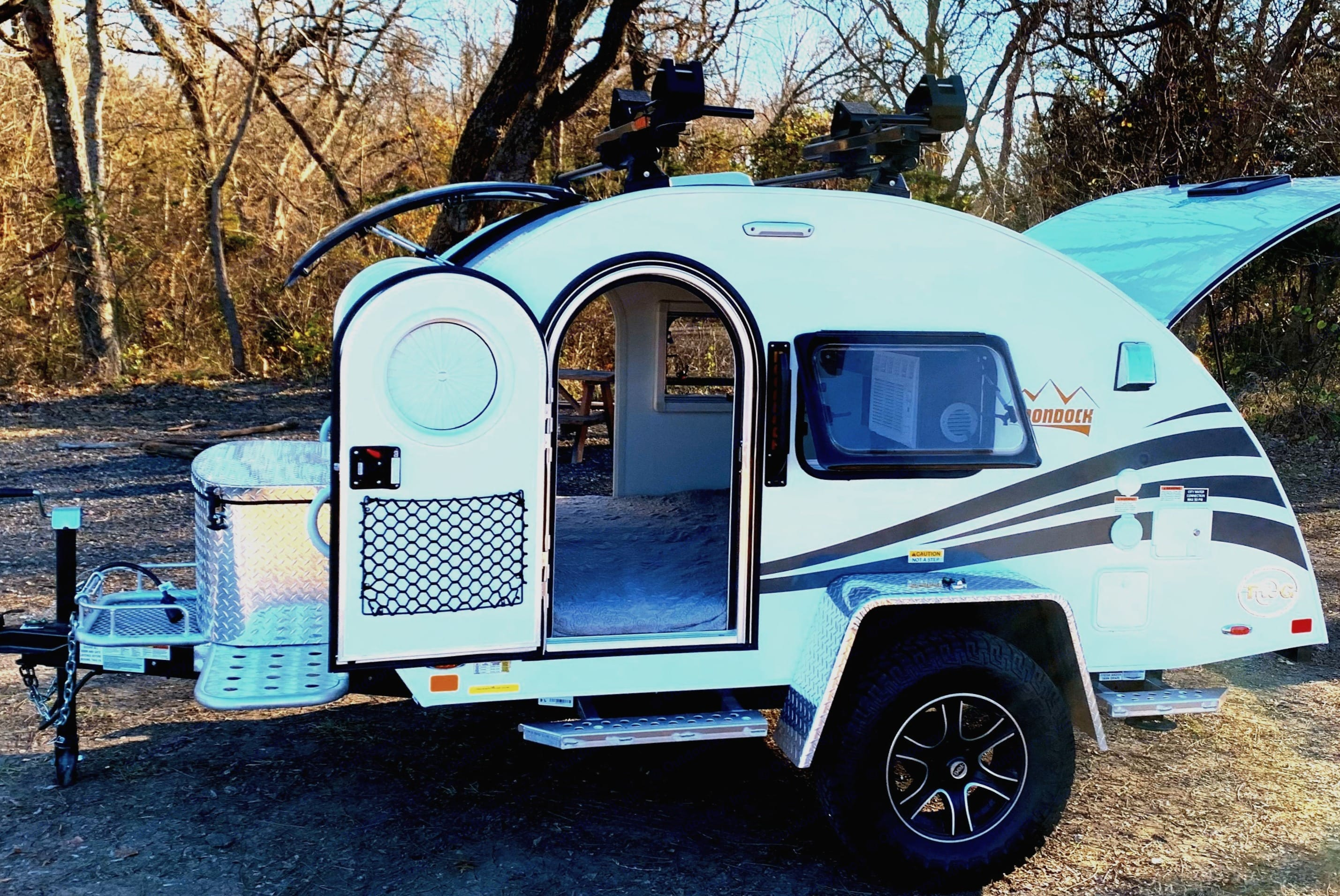 Easy access King size bedroom inside, outdoor galley out back, and easy load kayak rack on top. American Teardrop TRL 2021