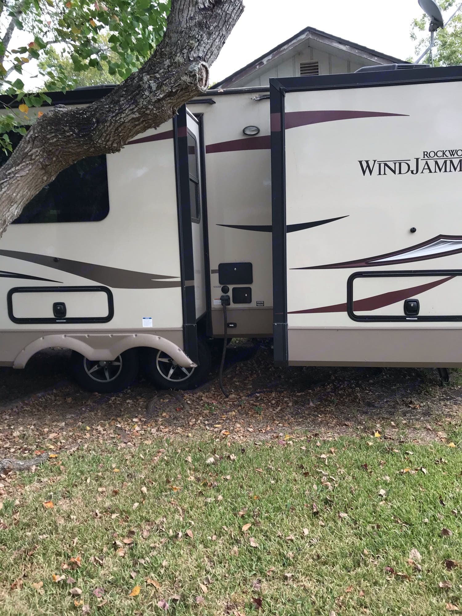 storage for table, chairs, rugs, sewage line tubing, wheel blocks. Forest River Rockwood Windjammer 2018