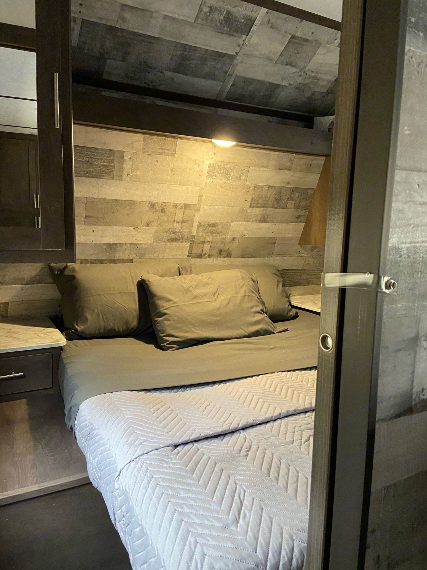 Sliding doors create a private master bedroom with queen bed and plenty of bedside storage. USB chargers built in.. Dutchmen Coleman 2021