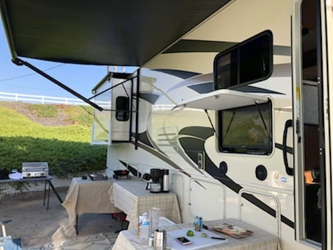 The awning is automatic.  Push of a button and you have instant shade.  The TV is perfect for watching the big game.  Outdoor kitchen less clean up!. Forest River Fr3 2017