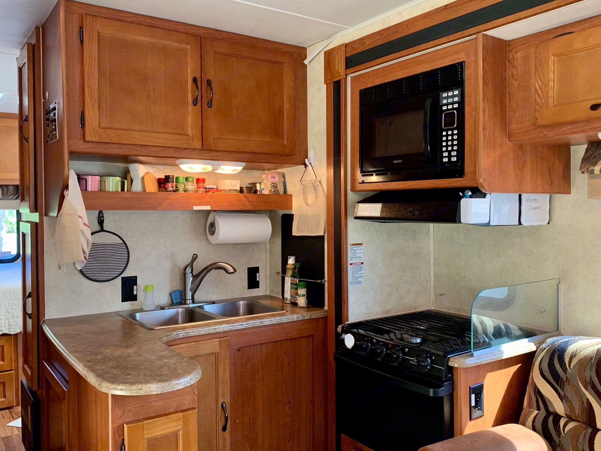 Spacious L-shaped kitchen with 3-burner stove, oven, microwave; nice counter space. Coachmen Freelander 2013
