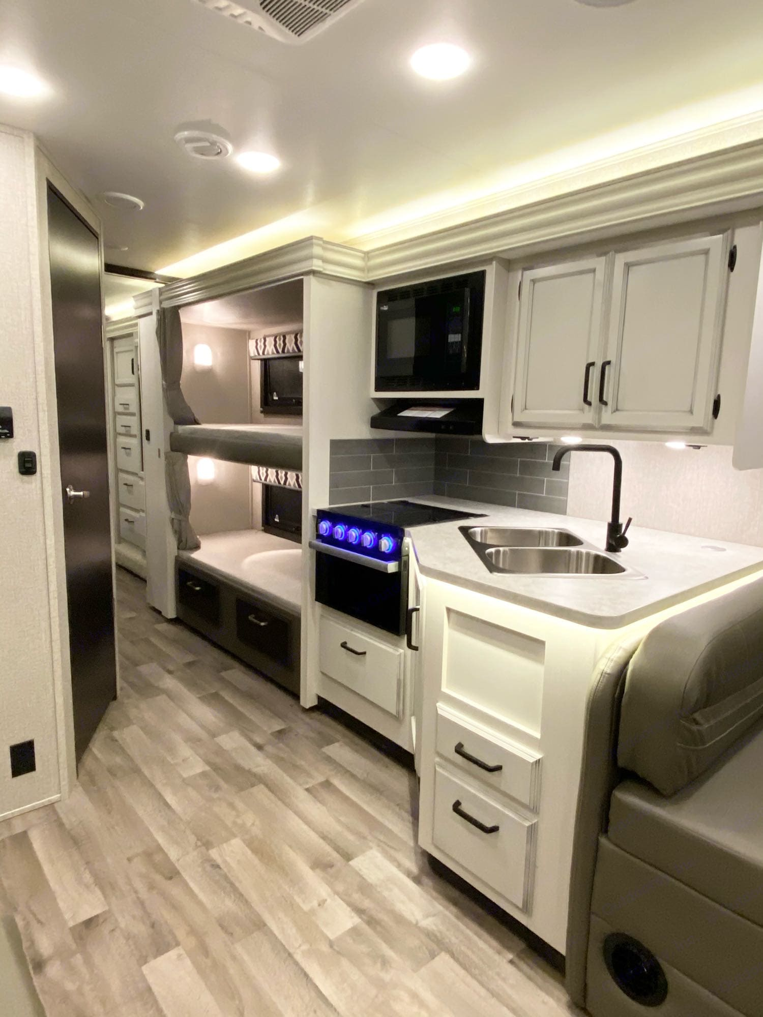 Kitchen space and peek into bunk beds. Jayco Redhawk 2021