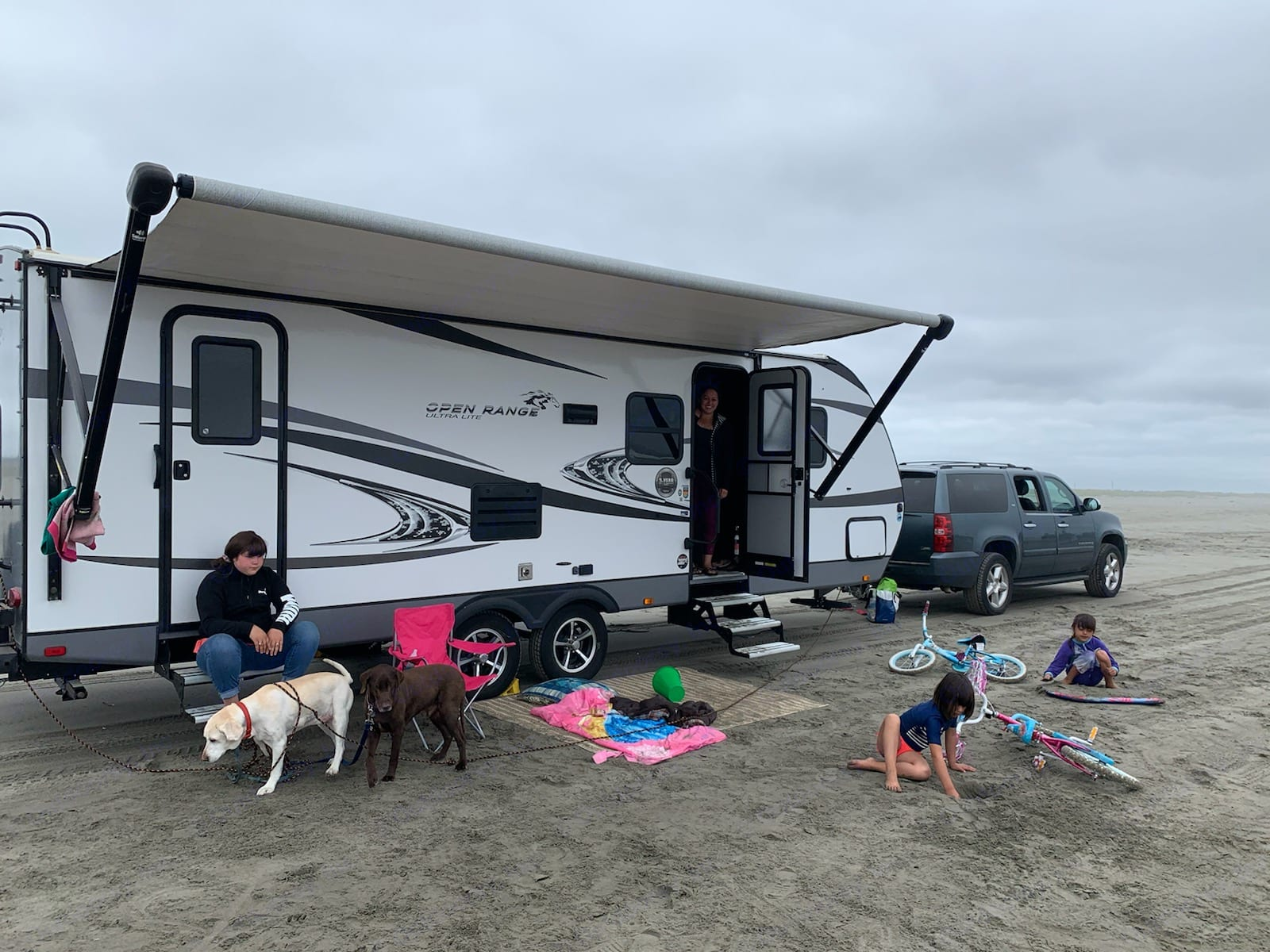 Our family chilling on the beach for a picnic . Open Range Open Range 2018