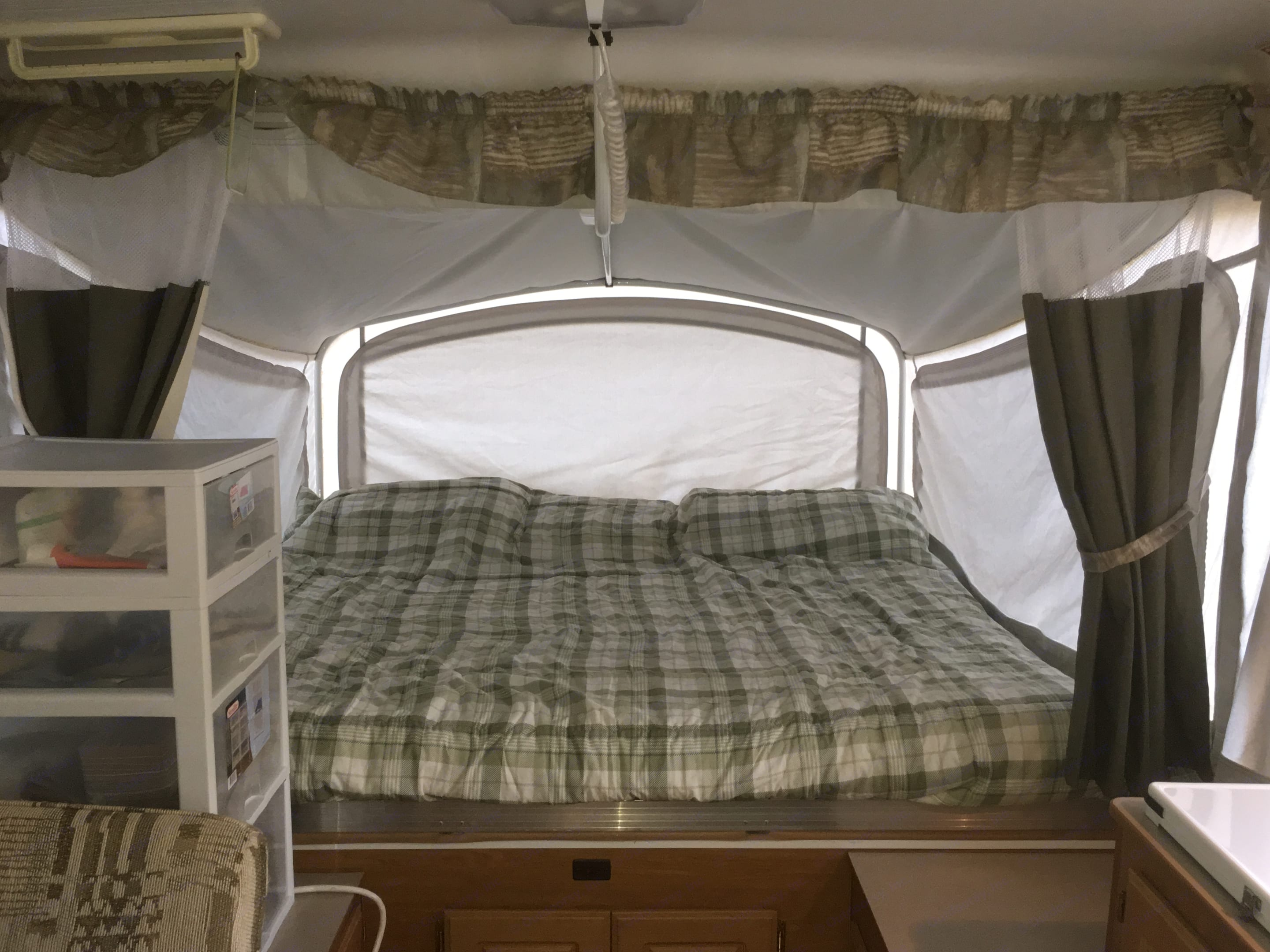 Both King Beds have 3 zipper window areas, these areas can be closed, or the sides have clear vinyl. All of them can fully open for nice breezes.. Coleman Americana Bayside 2003