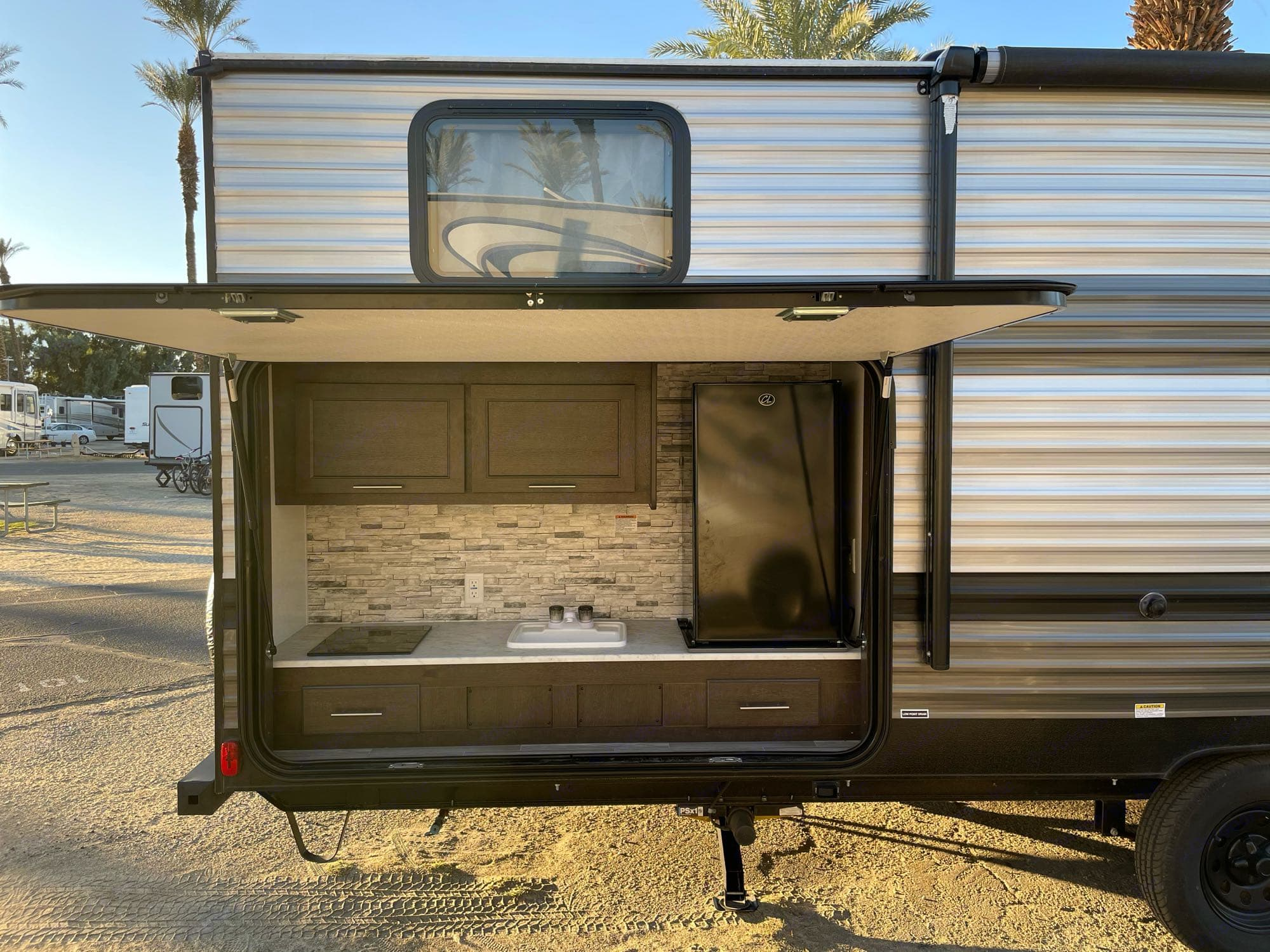 half kitchen, stove, sink and small refrigerator. Forest River Salem Cruise Lite 2020