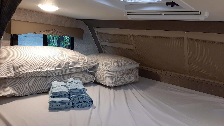 Overhead Queen-sized Bed (58 in x 84 in). Adventurer Class C 2018