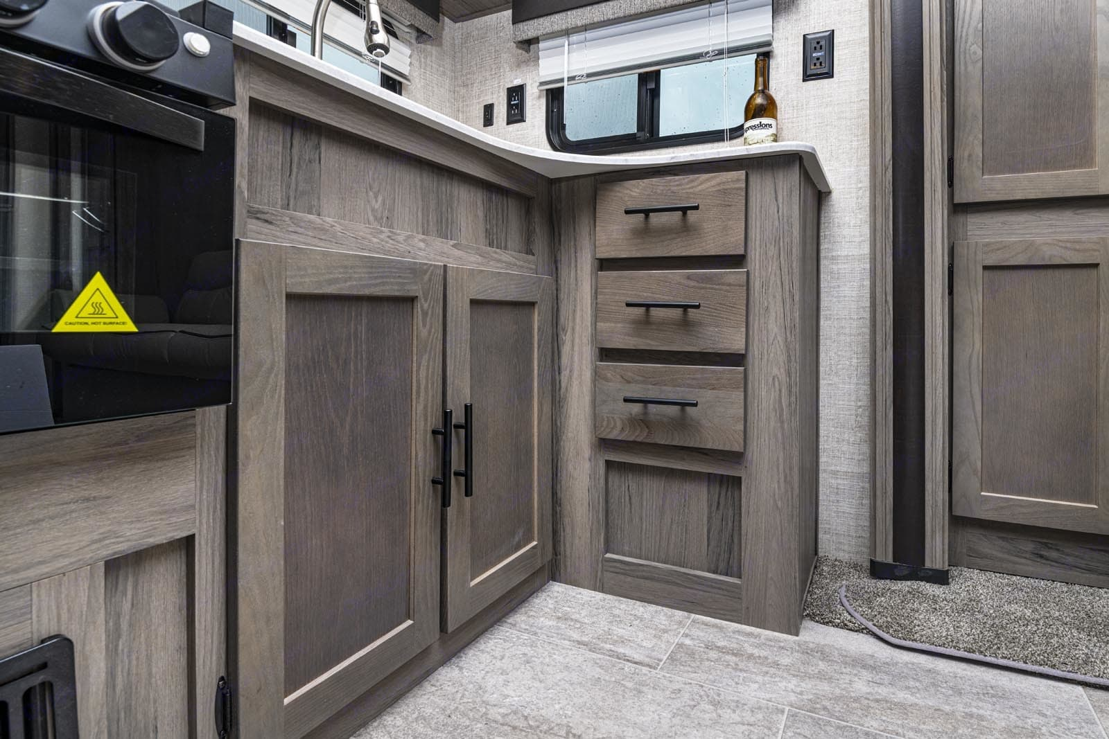 There are three shelves and two  drawers under the countertop.. Gulf Stream Amerilite 2021