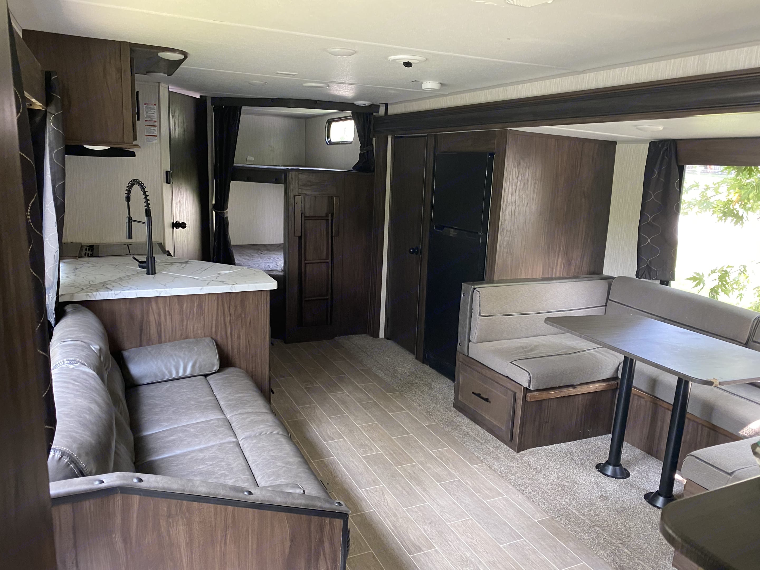 large living room space. Forest River Cherokee Grey Wolf 2021