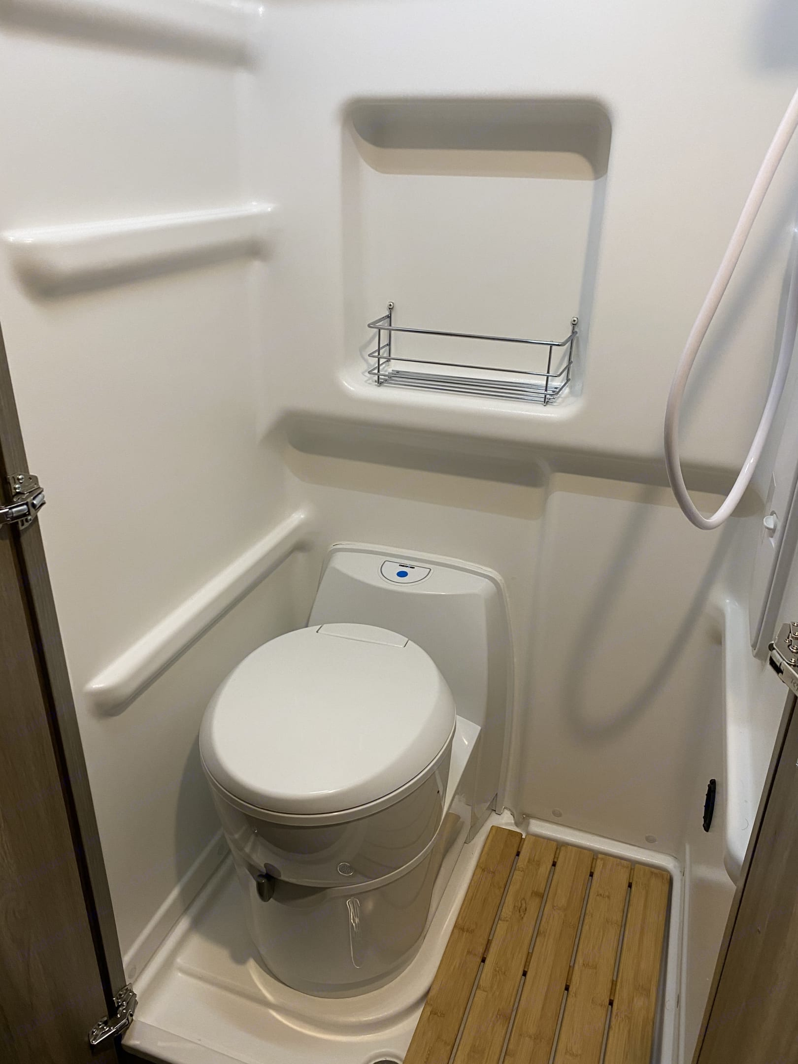 This is the bathroom with a toilet and indoor shower (not available to renters).. Winnebago Solis 2021
