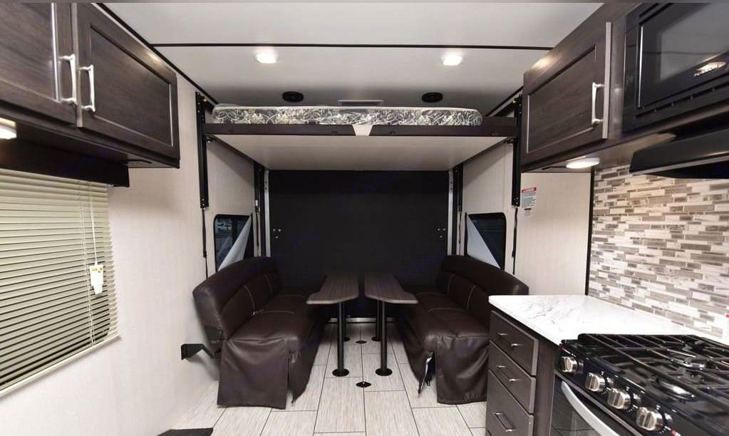 Bed lowers down and benches convert to comfortable bed. Both are full-size. Pacific Motorworks SURFSIDE 2021