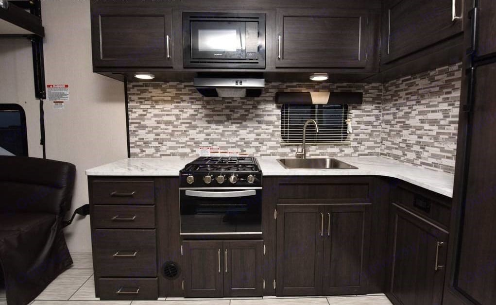 Excellent storage, and full functional kitchen and refrigerator (just a little smaller than you're used to at home. Pacific Motorworks SURFSIDE 2021