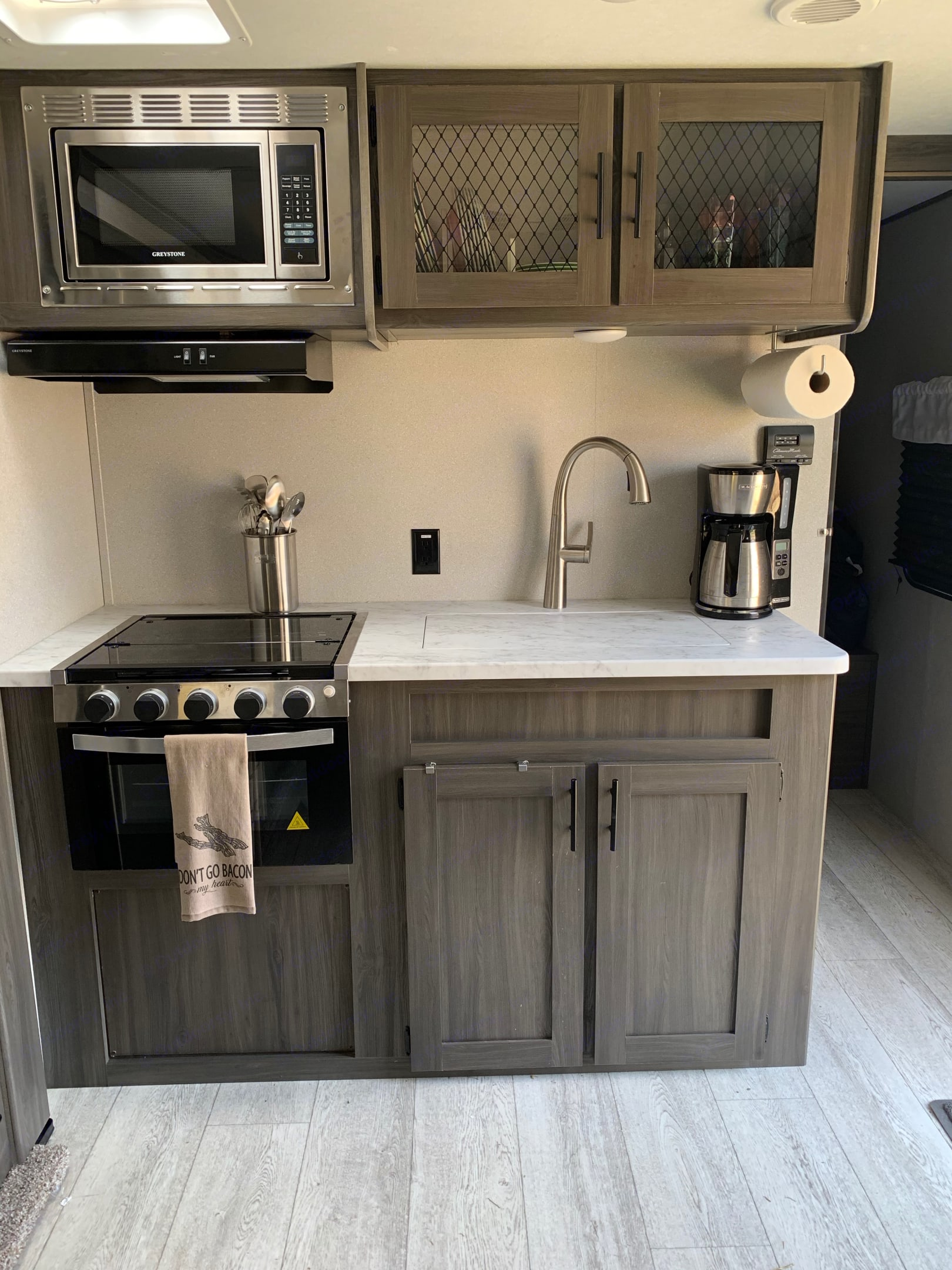 Kitchen area comes with 3-burner stove, oven, microwave, coffee maker, pots, pans, utensils, knives, and so much more. . Shasta SALEM25RS 2021