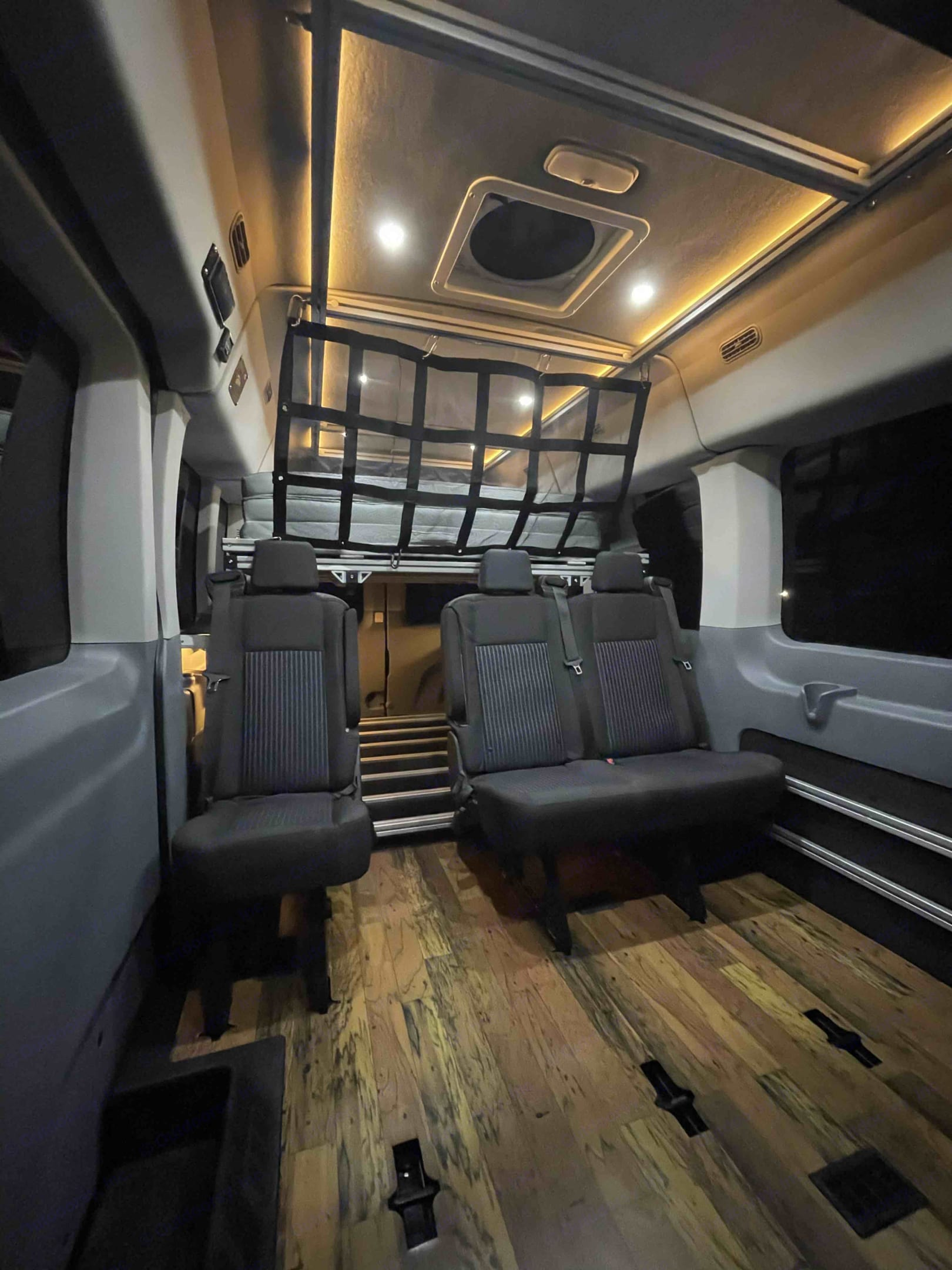 This has the bed leaf all folded up, the mattress stored away and the cargo panel installed. We are ready to hit the road!. Ford Custom Transit VanDOit Adventure Van 2019