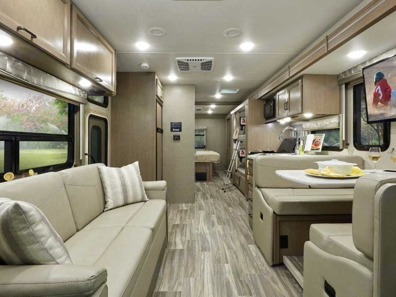 this is the interior view of the RV from the front driver position looking back. . Thor Motor Coach A.C.E 2021
