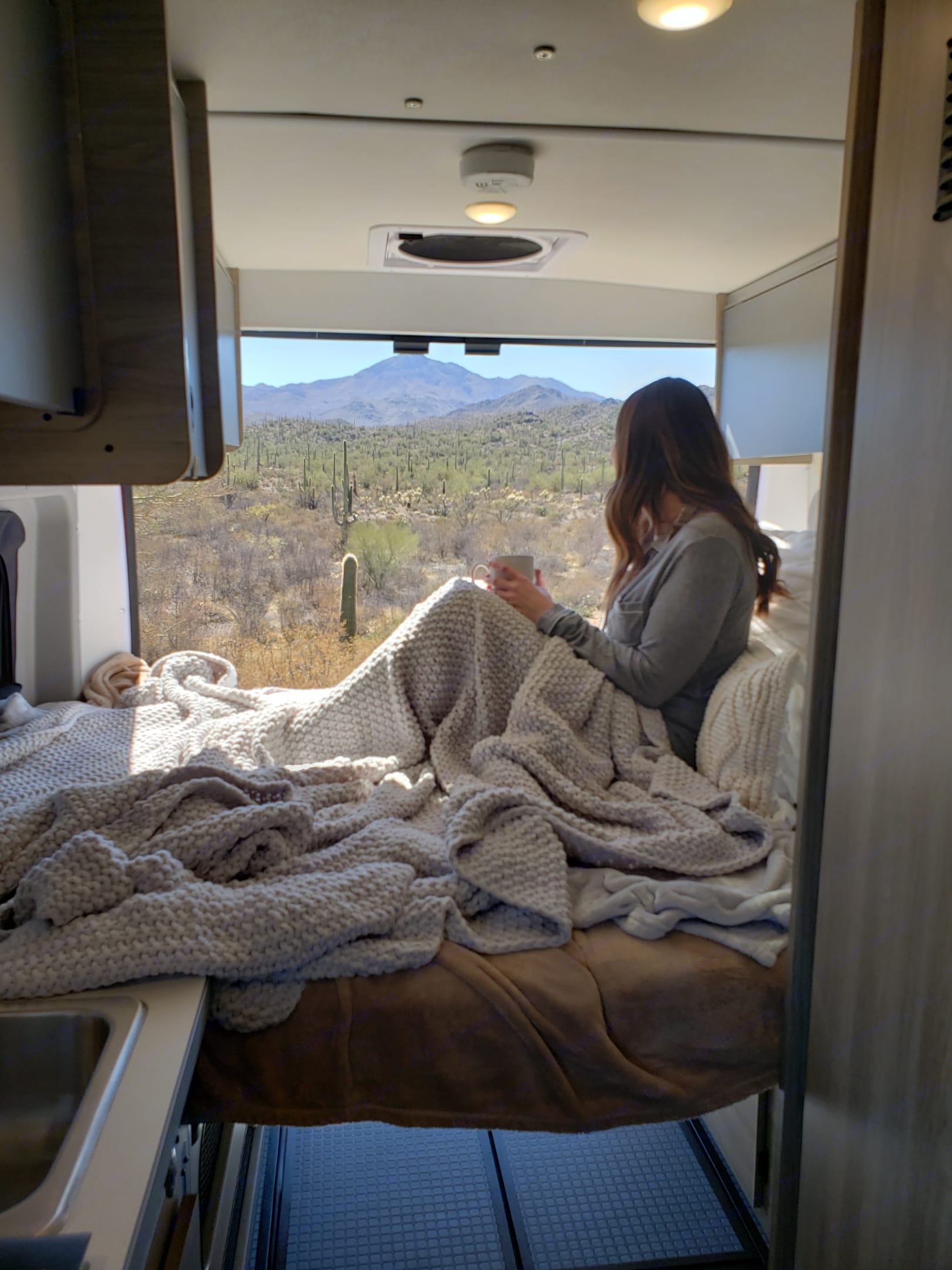 Cozy Back Queen Sized Bed For The Best View From Bed. Winnebago Solis 2021