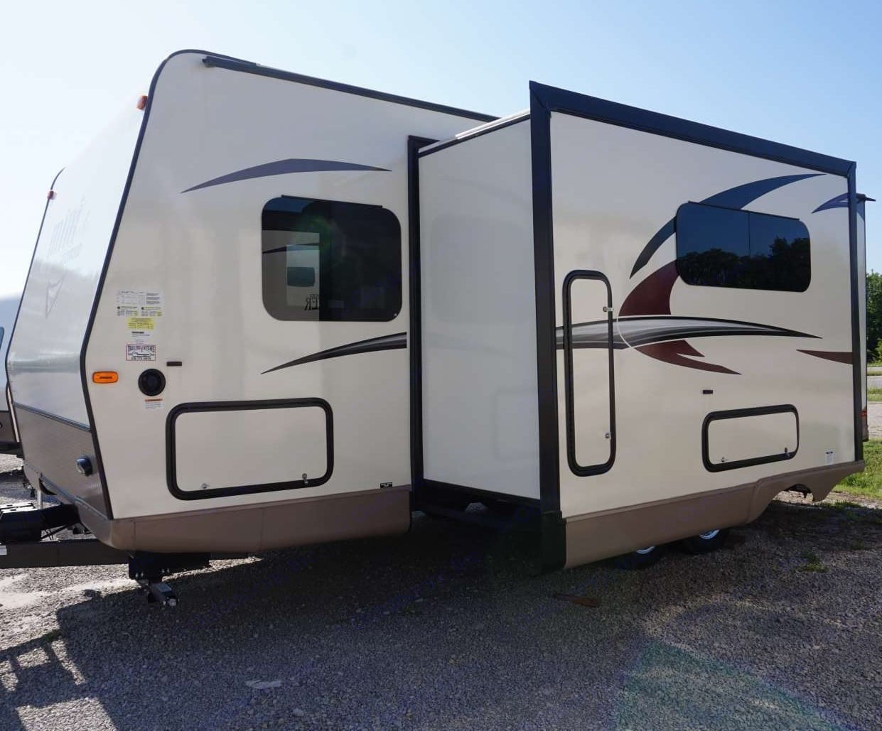 Slide out with photo of storage where broom is located. Forest River Rockwood Mini Lite 2509S 2017