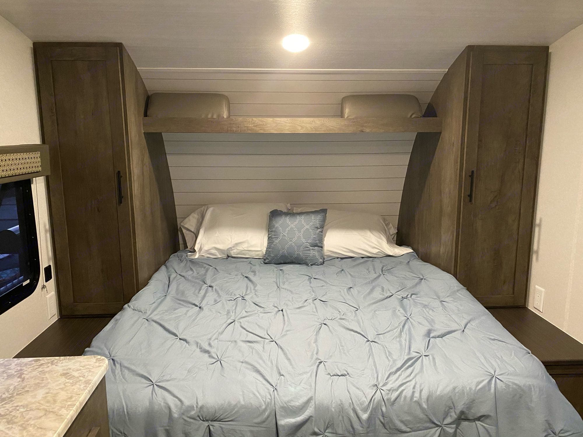 couch converted to queen Murphy bed. Forest River Cruise Lite 2021