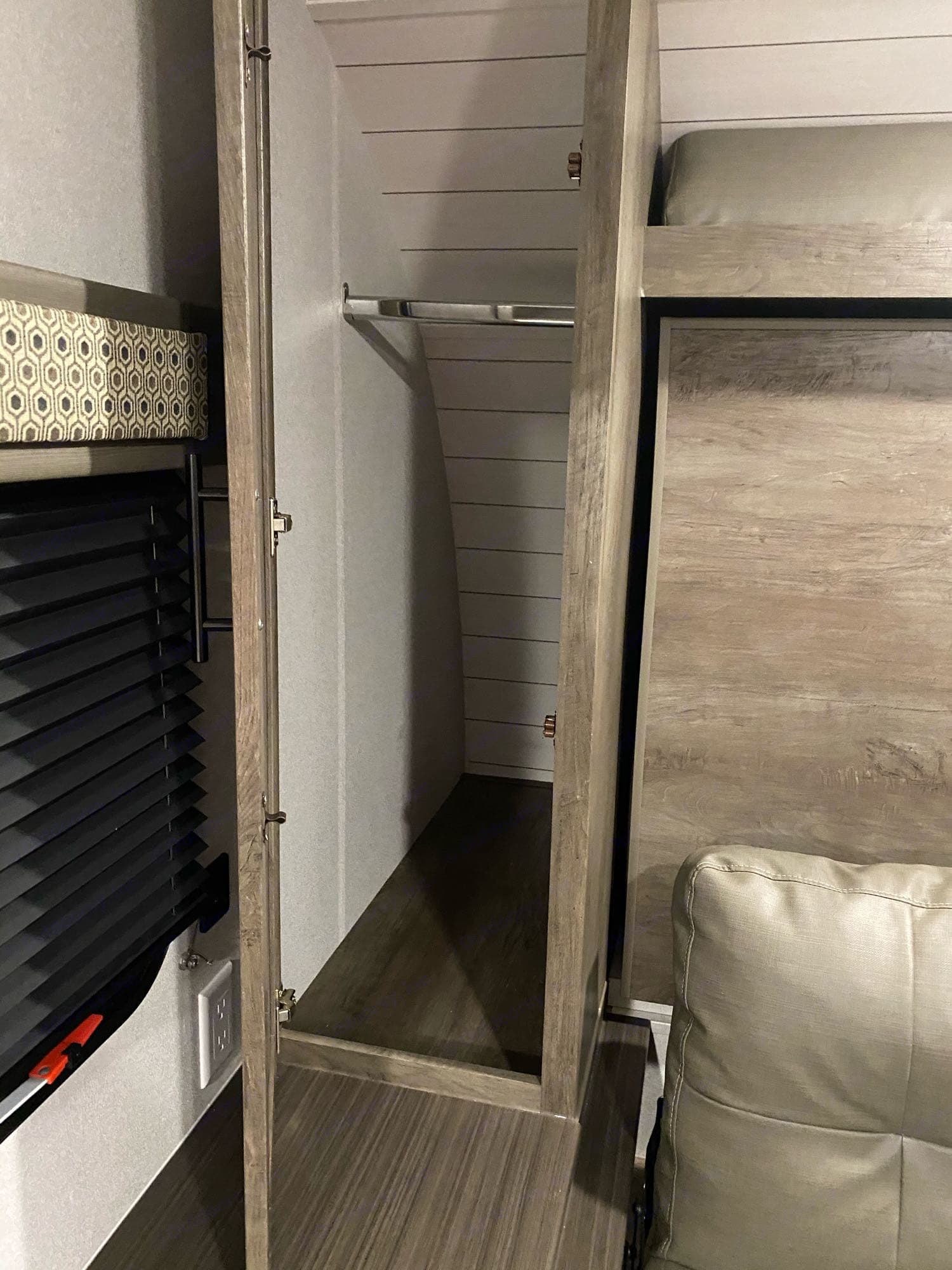 closet space on each side of the bed. Forest River Cruise Lite 2021