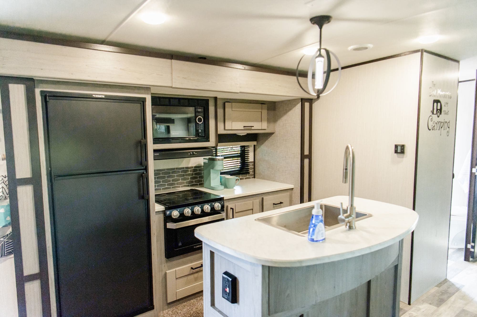 Spacious kitchen fully equipped with plates, utensils, cups, Keurig, pots/pans, baking dishes, measuring cups, mixing bowls and more!. Heartland Mallard 2020