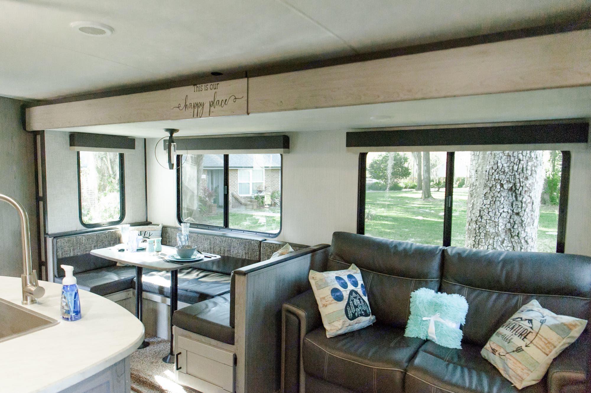 Dinette & couch both convert to beds. Heartland Mallard 2020