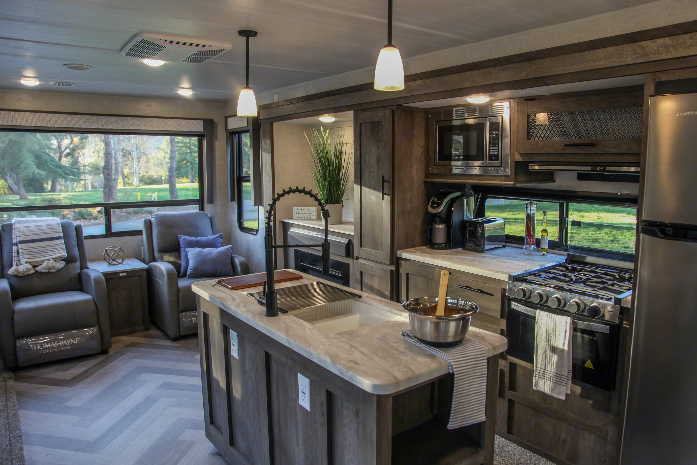 Spacious kitchen with island . Forest River Wildwood 2021