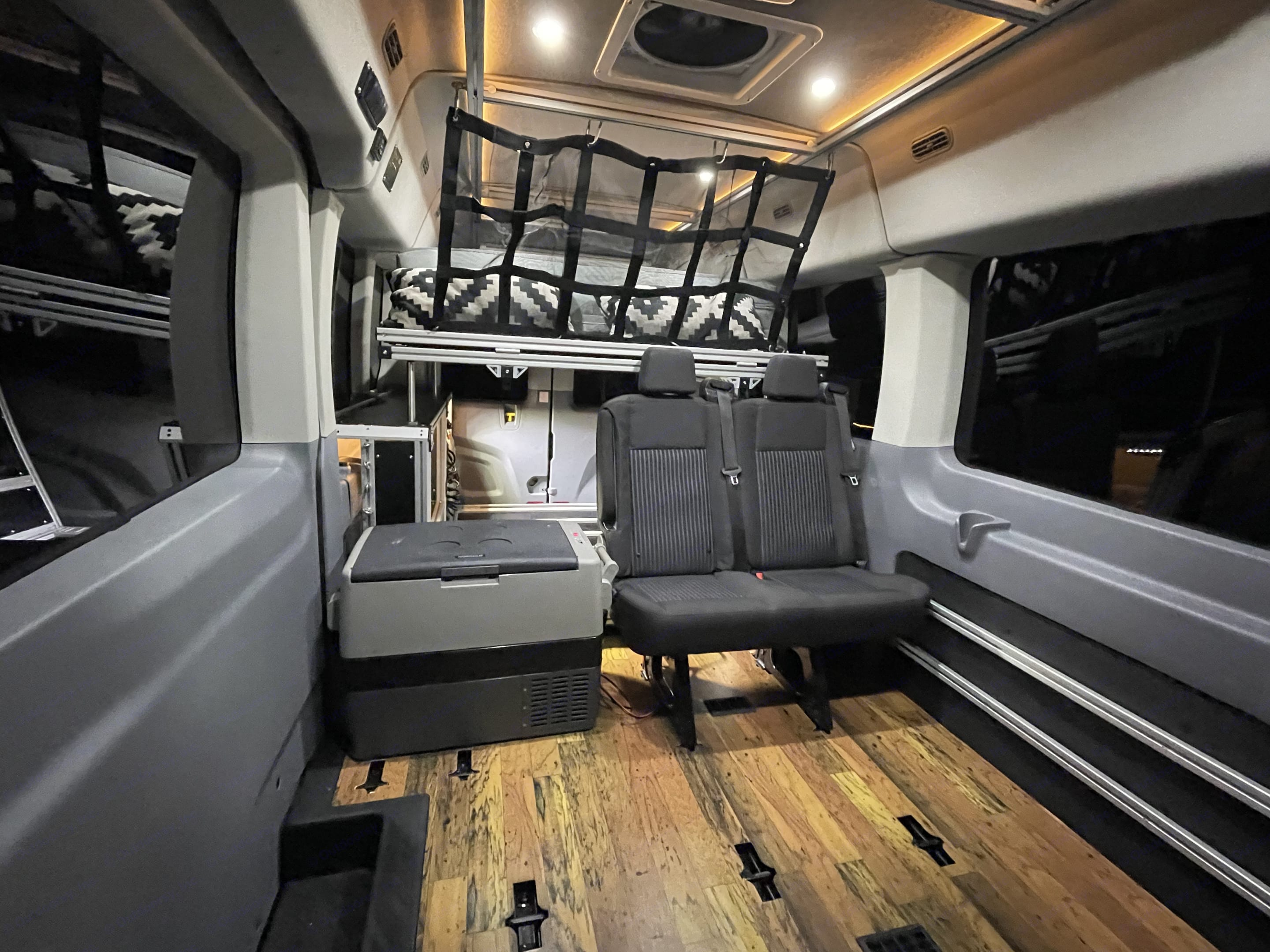 To show a bit of the versatility, we pulled out a seat and put our electric cooler in that is running off the van's power to keep your food and drinks nice and chilly with no need for ice!. Ford Custom Transit VanDOit Adventure Van 2019