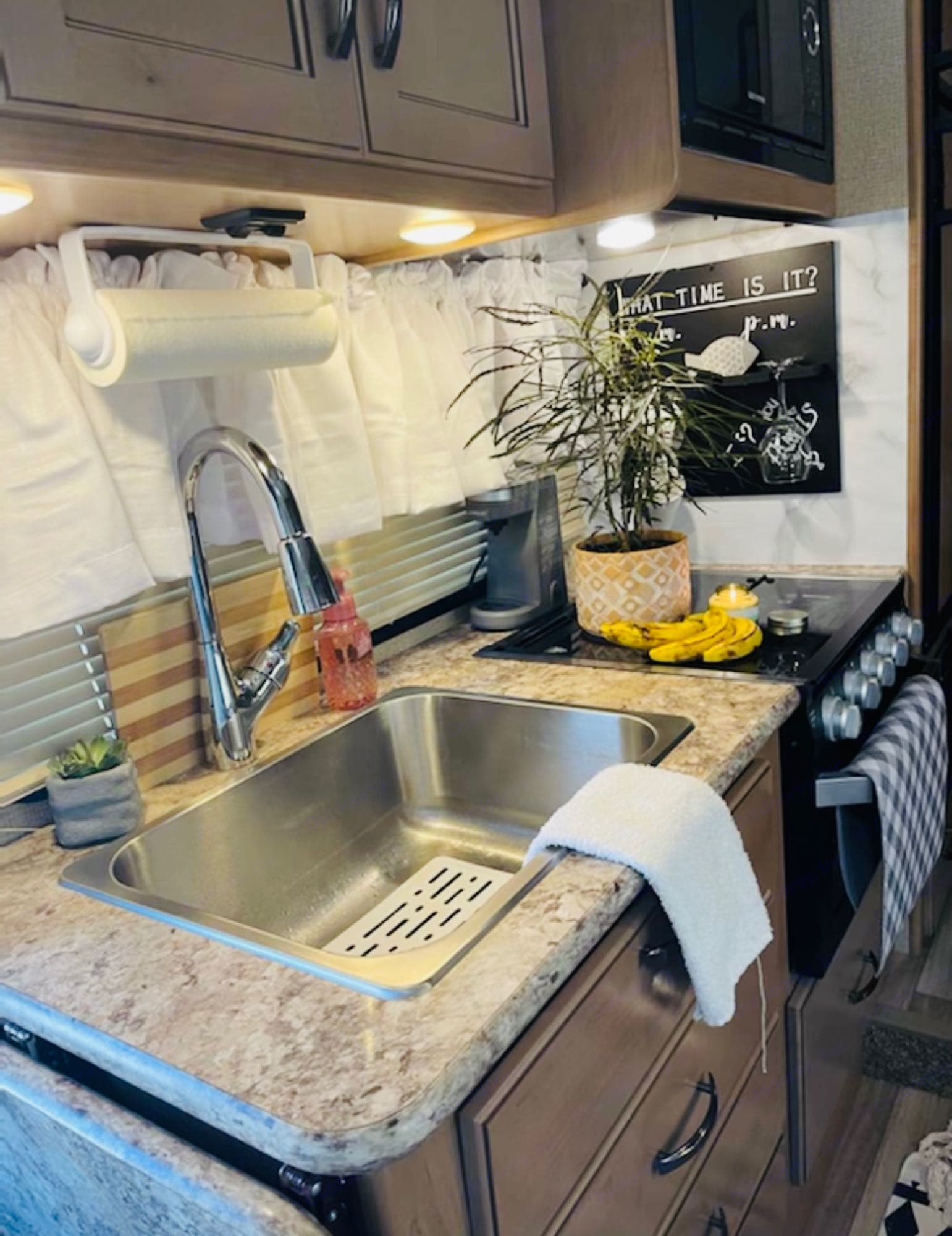 Large Stainless Sink, Pull out Faucet Sprayer, drop down counter top adding extra space for the included coffee maker!. Thor Motor Coach Four Winds 23B 2019
