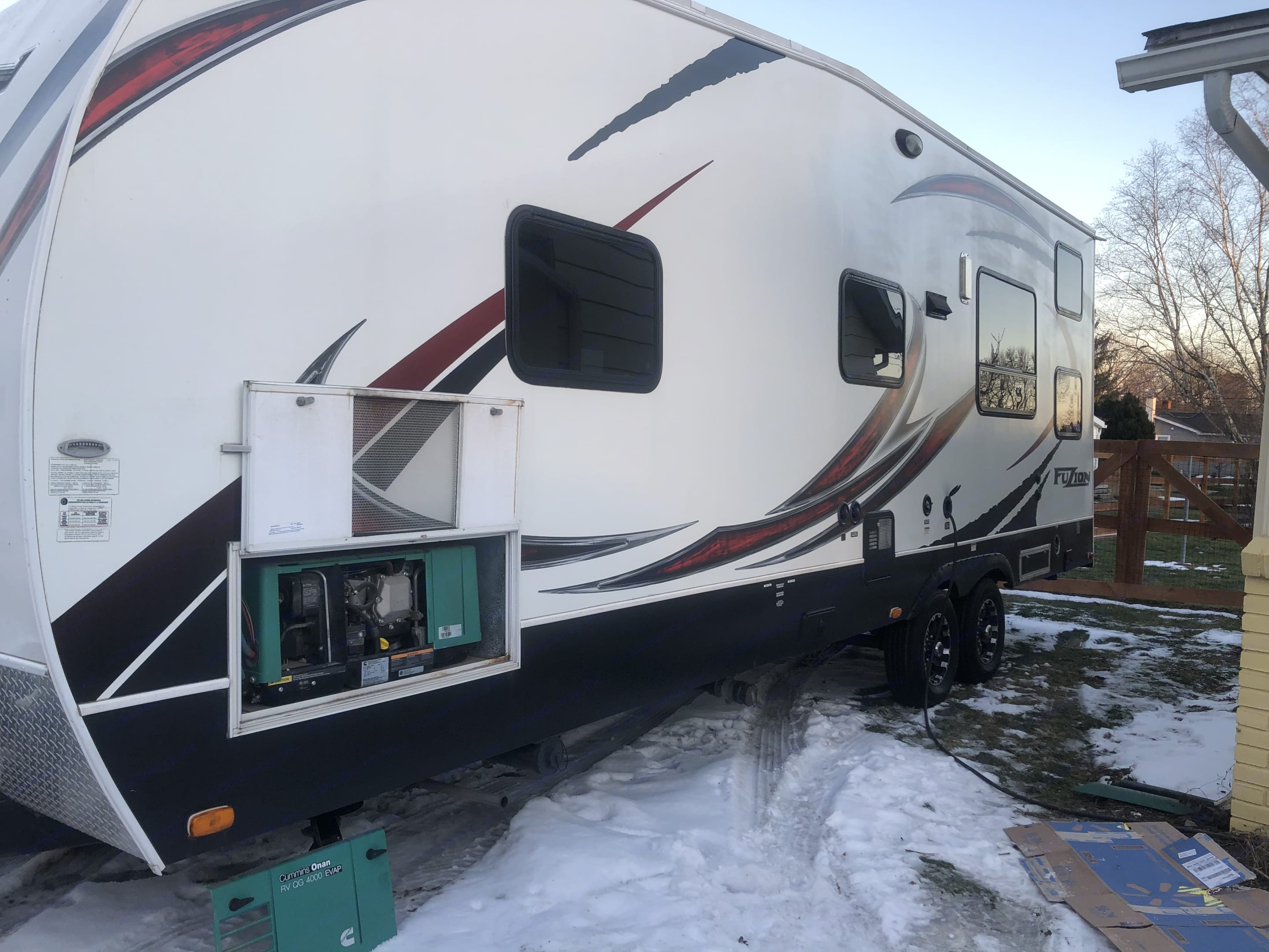 This side of the RV has the onboard generator, outside shower, and all RV hookups.. Keystone Fuzion 2014