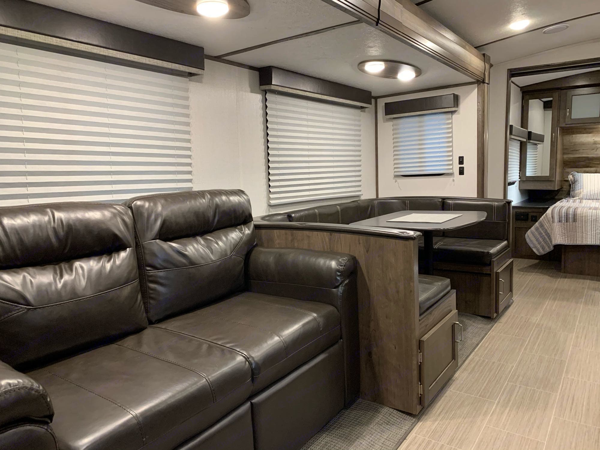 Sleeper Couch, Dinette Converts to Bed. Keystone Passport 2021