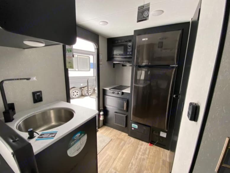 Full Size Fridge and Indoor Stove. Forest River Cherokee Wolf Pup 2021
