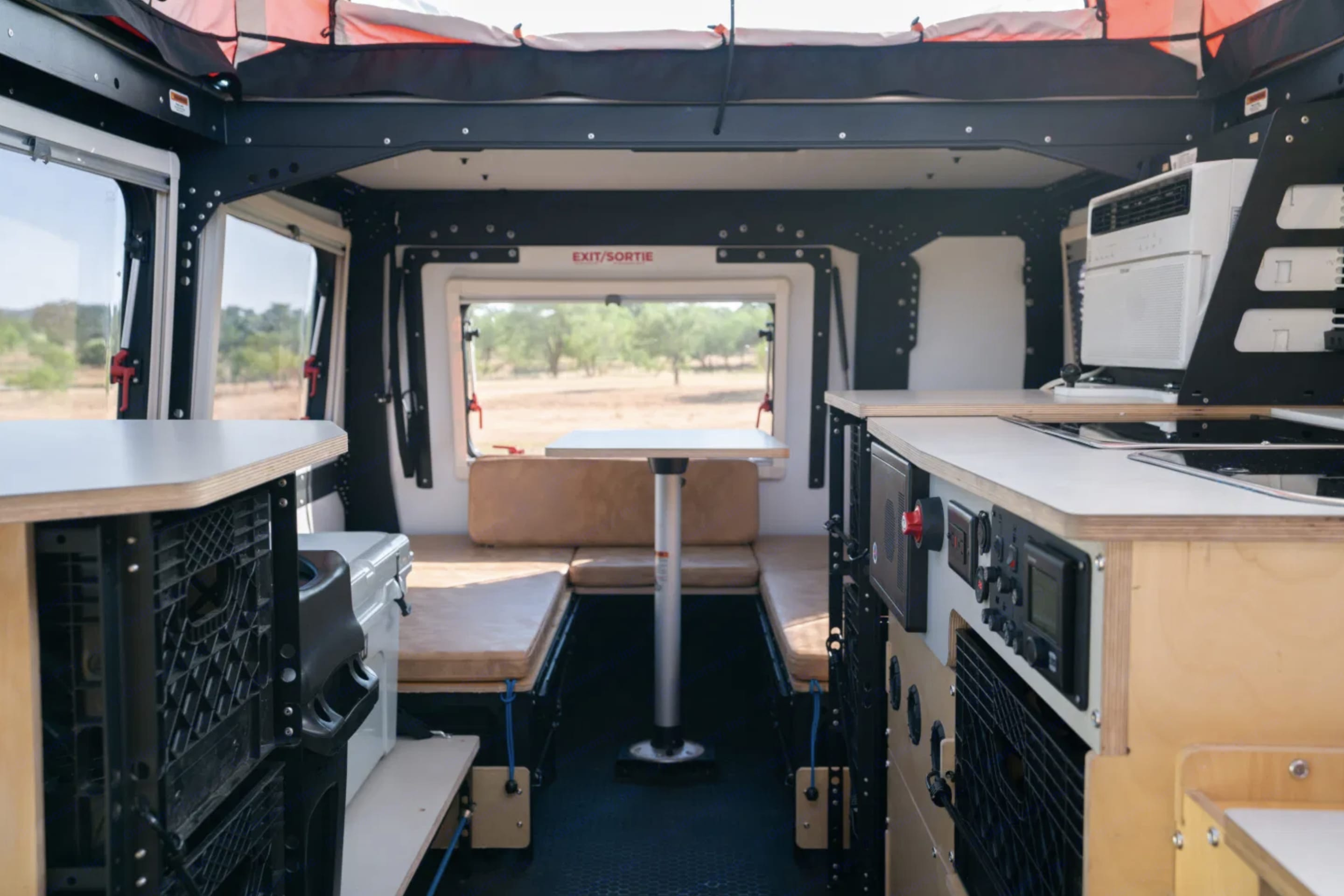 A view through the kitchen and into the dinette area with the rear door closed.. TAXA Outdoors Mantis Camper 2021
